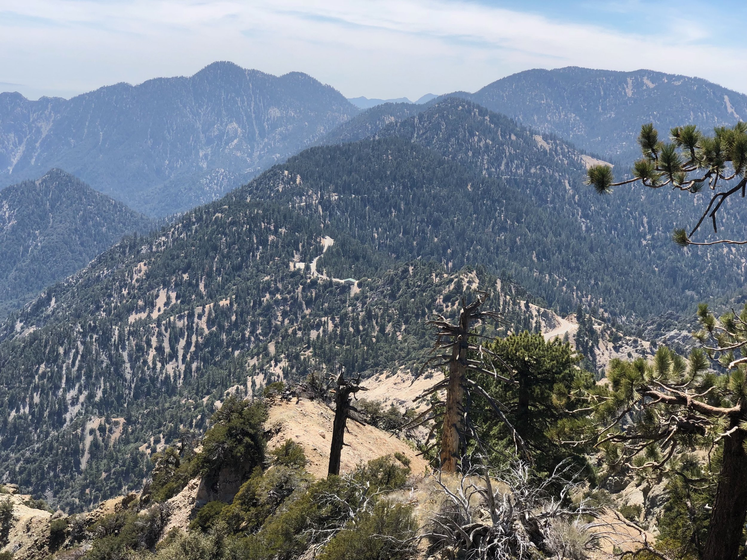 The highway you can barely see in the forest is CA 2, or more commonly called Angels Crest Highway.  It would be a fun ride on a motorcycle.  In fact, I think I'll do that after the PCT.
