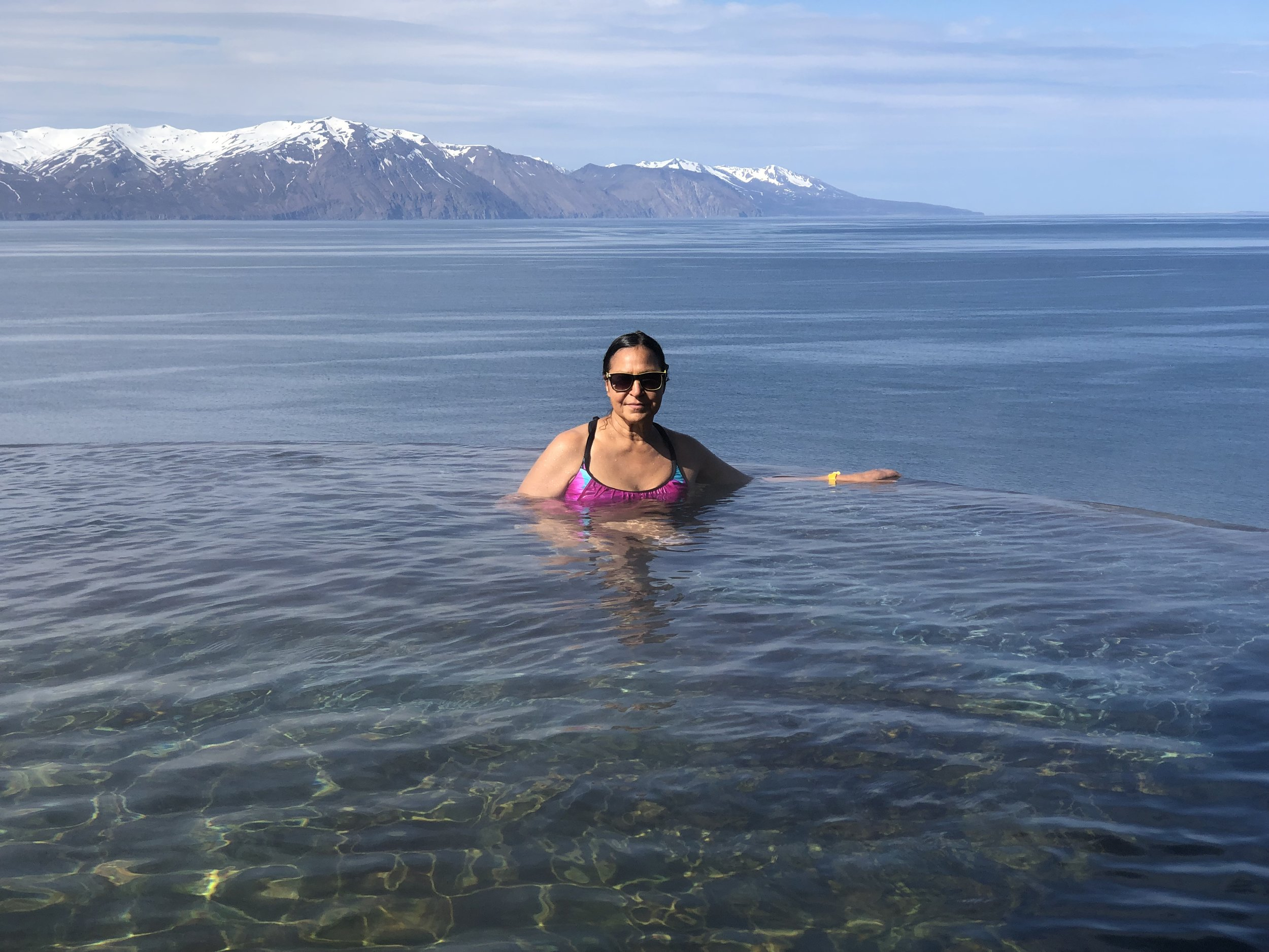 The negative edge hot pool in Husavik gives the impression Alena is swimming in the frigid Arctic Ocean.