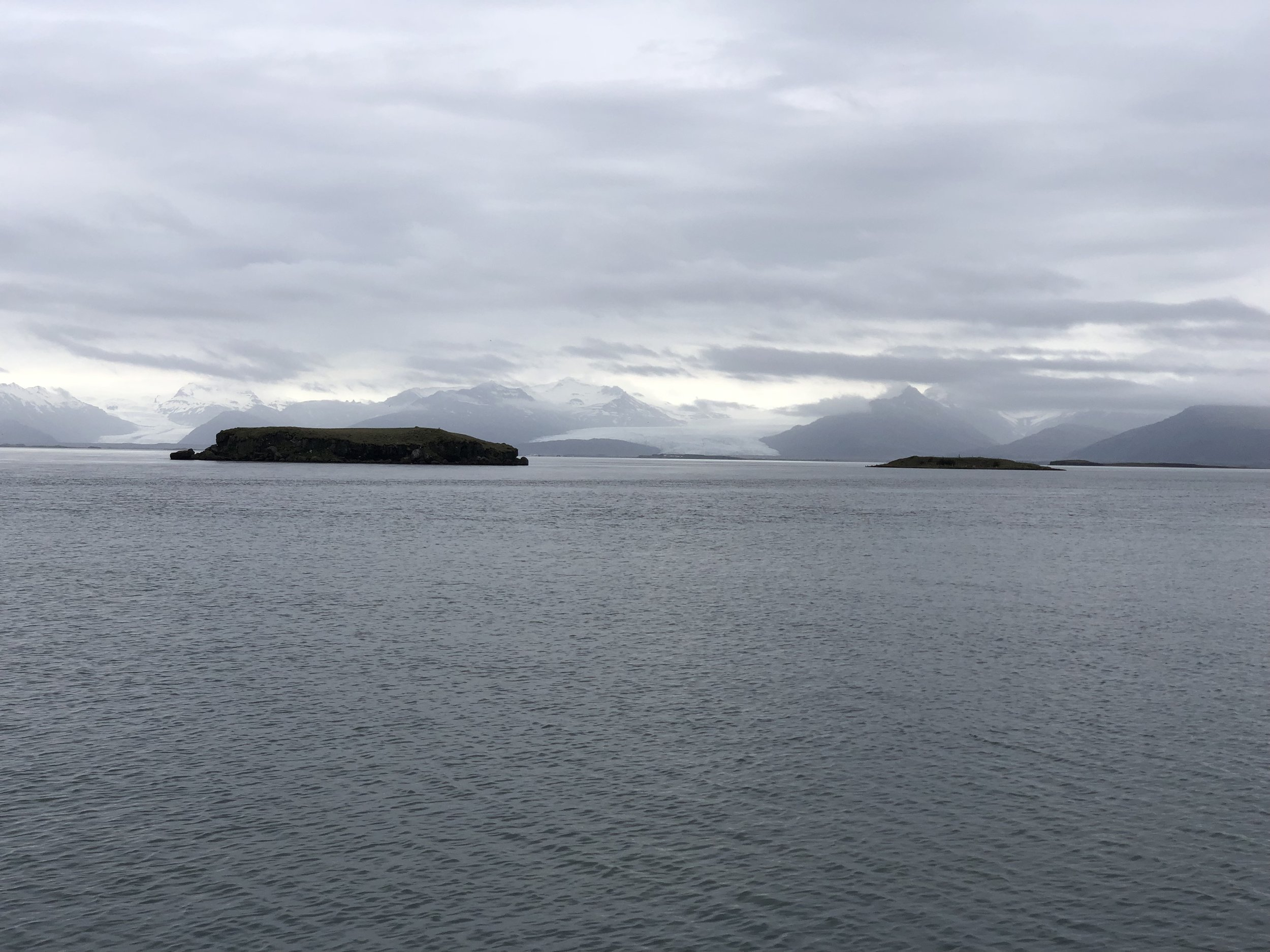 In the distance are two glaciers flowing toward the bay.