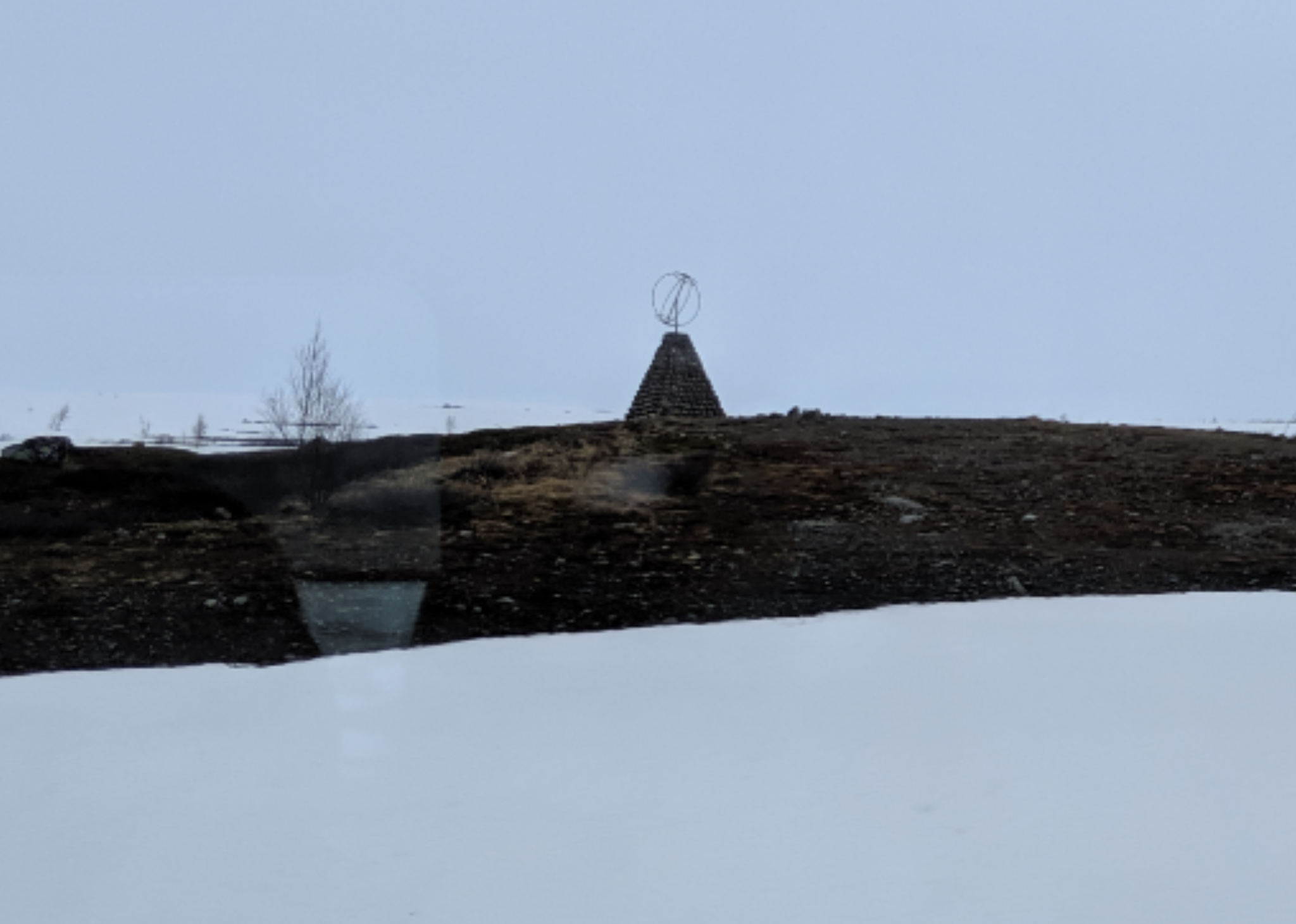 This photo was also taken from the train. It is a photo of the Arctic Circle marker.