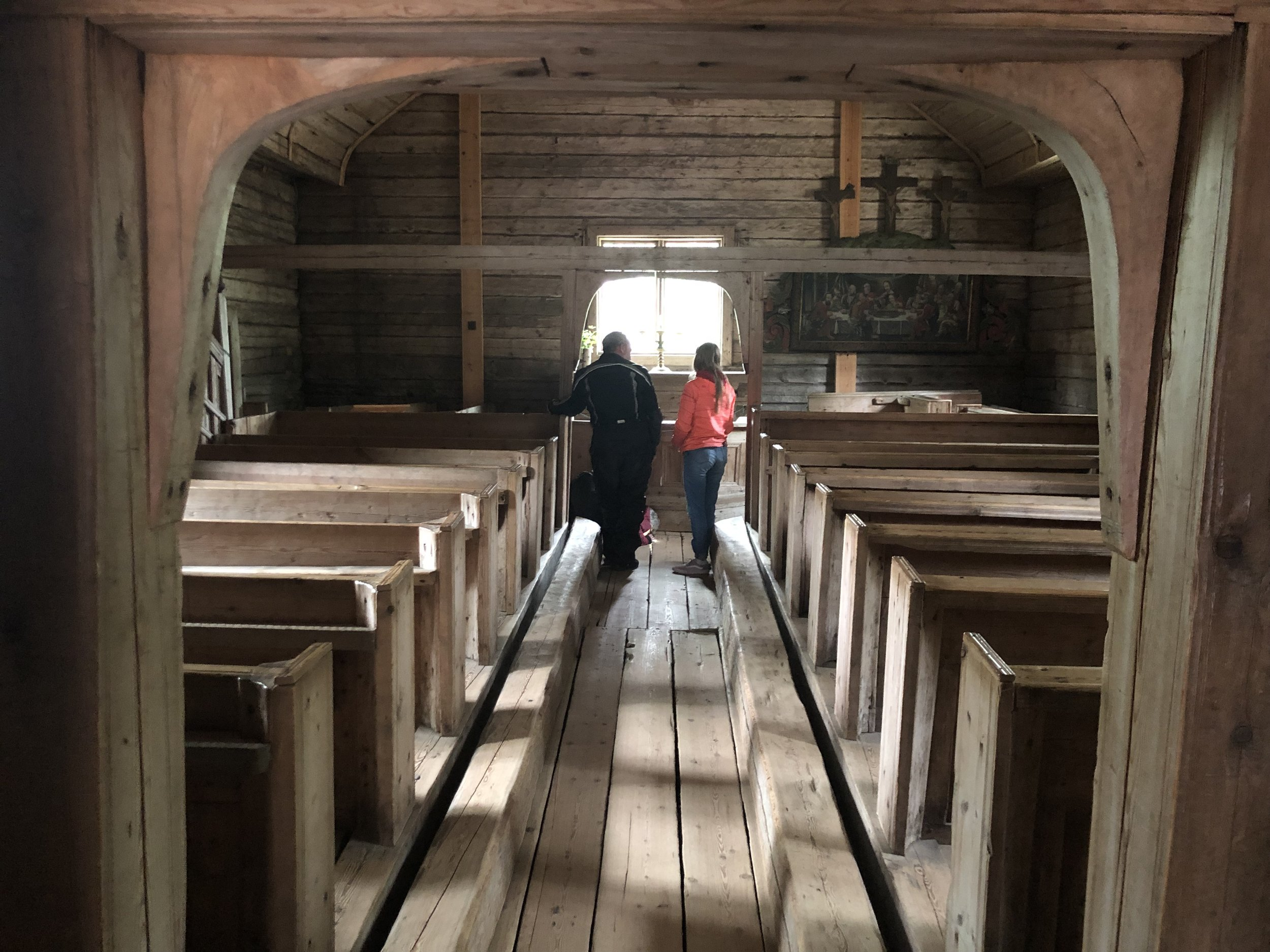 This is the inside of the oldest wooden church in Northern Finland. When this church was still active, members of the congregation would sometimes be allowed to bury family members under the floor. We looked through the cracks in the floor and saw the skeletal remains of a child and a man that were buried there many years ago.