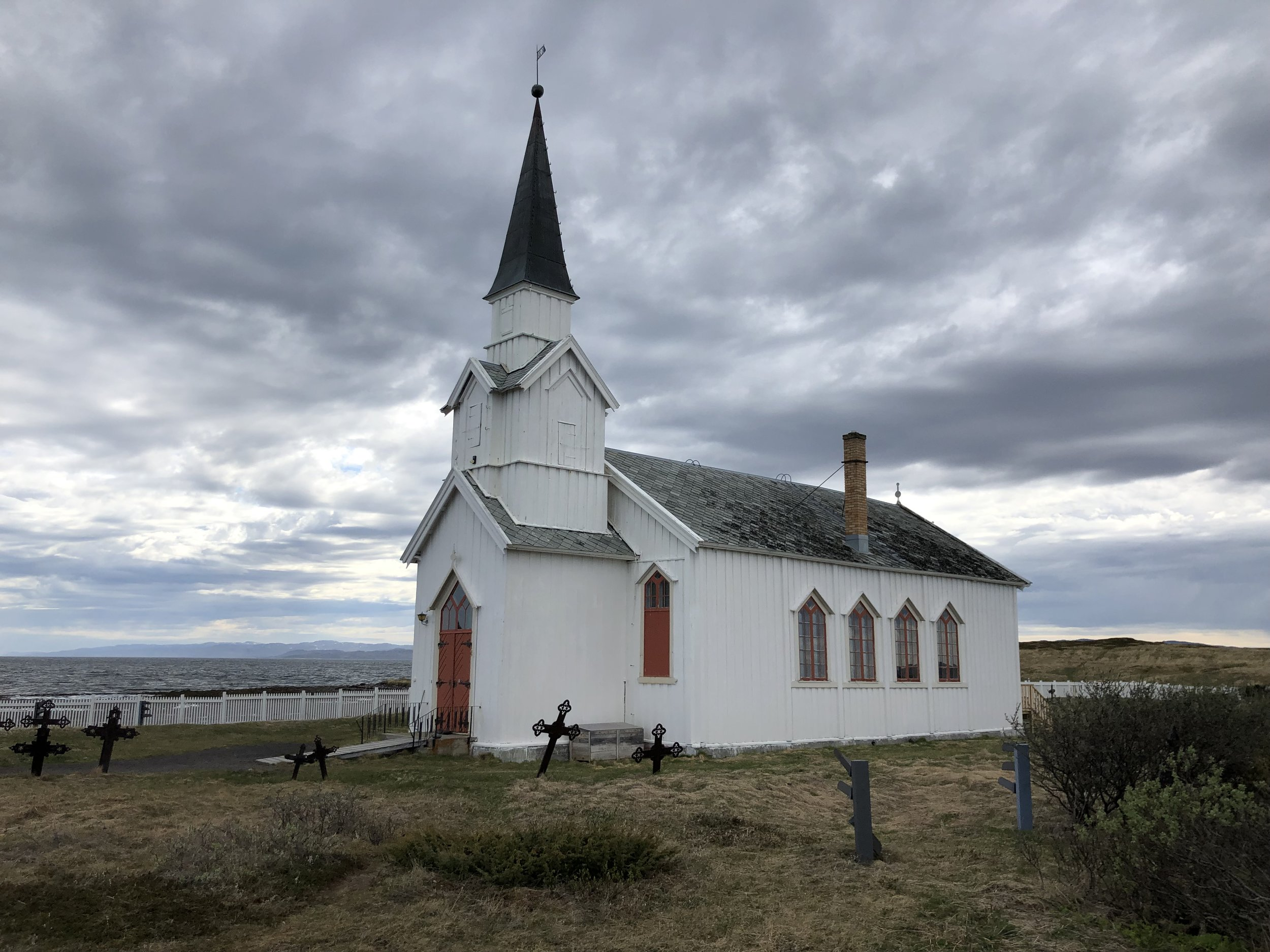 Small active church along the Norwegian coast above Finland.