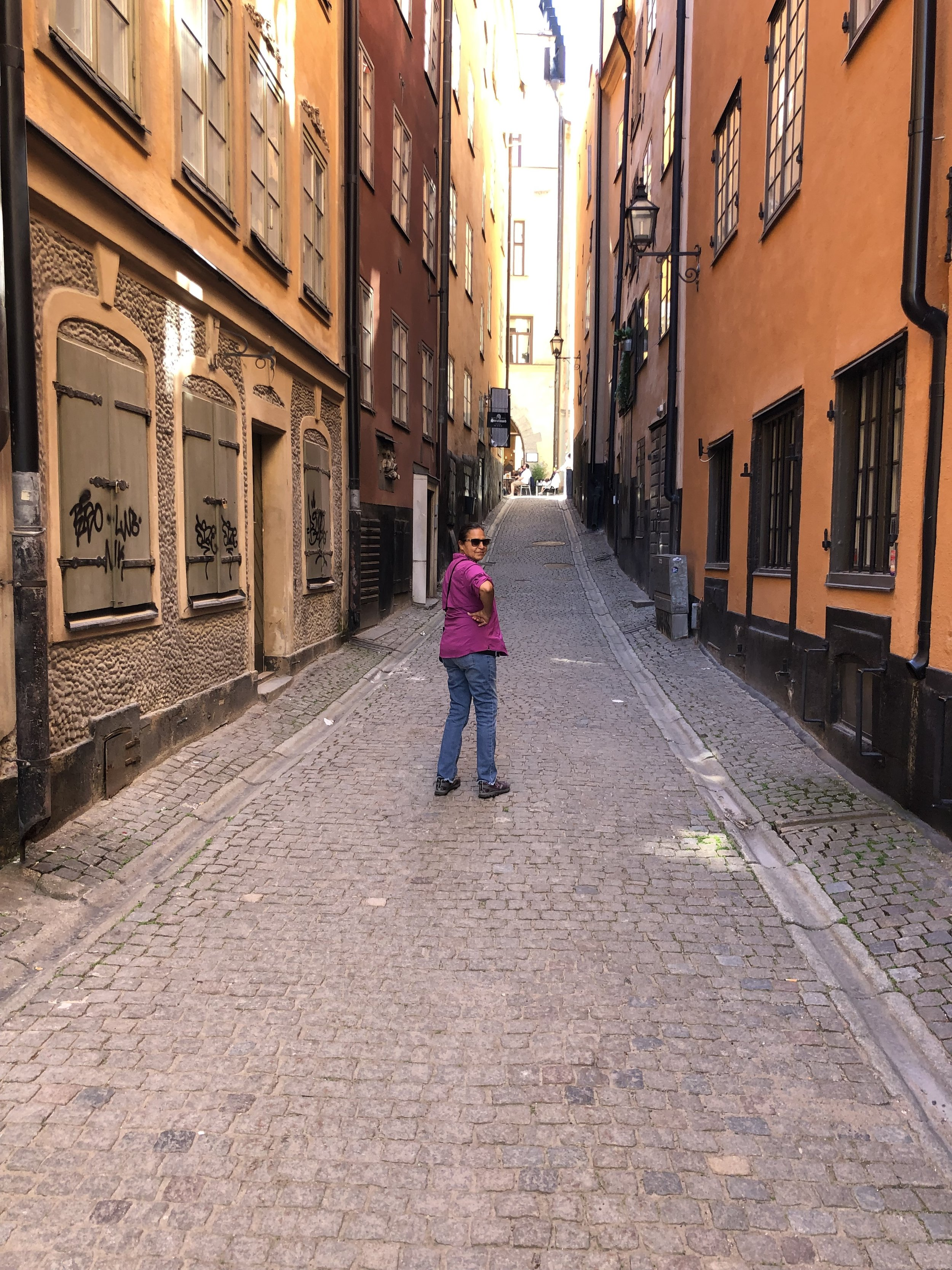 Alena heading up a narrow street in Gamla Stad, which is a old city that surrounds the royal palace.