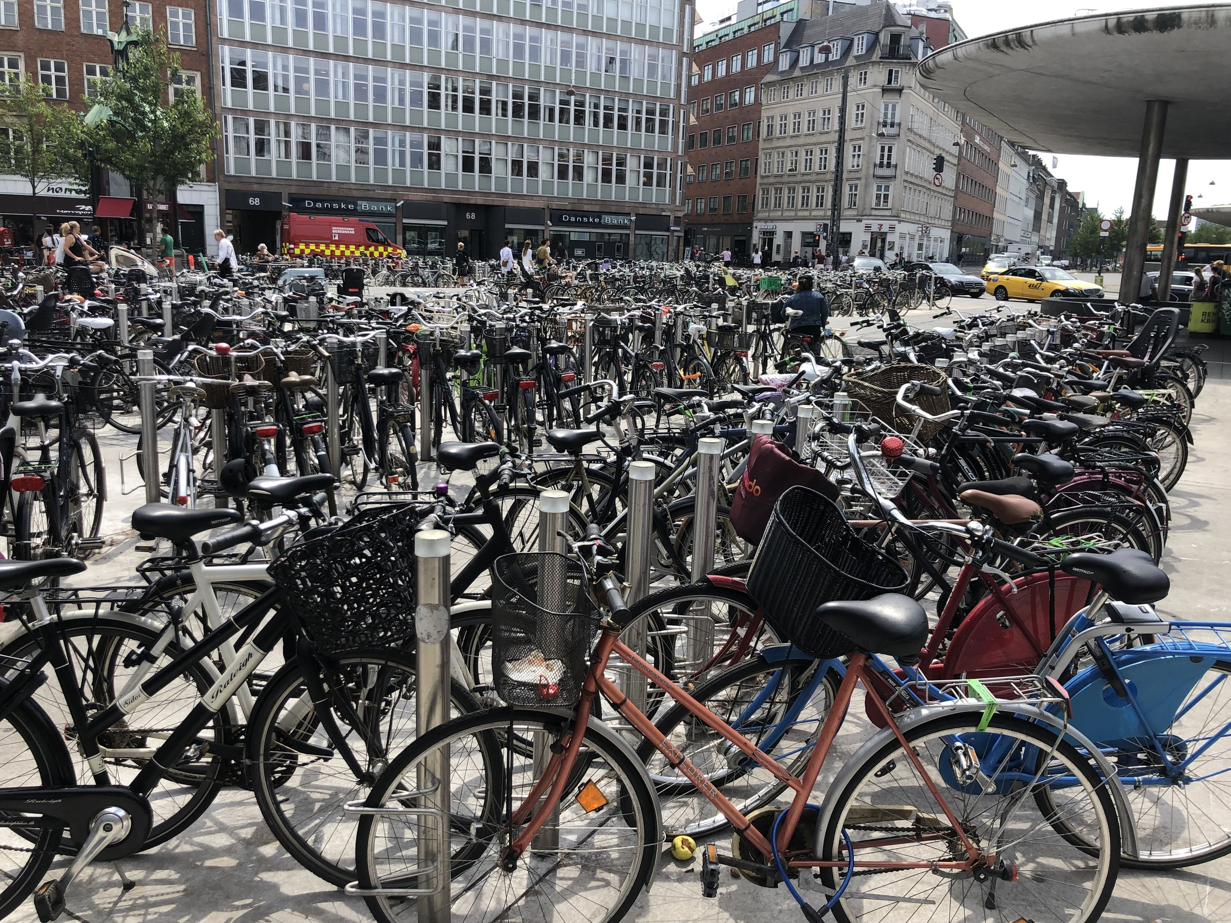 Once we got to Copenhagen we immediately noticed there were thousands bicycles all over the place including large areas like this one where bicycles could be temporarily stored. Later we learned that Copenhagen city leaders had made it their mission to get the citizens out of their cars to reduce pollution and congestion. As a result, there are more bikes than you can imagine in this city. There are also special bike lanes where they ride with their own traffic lights.