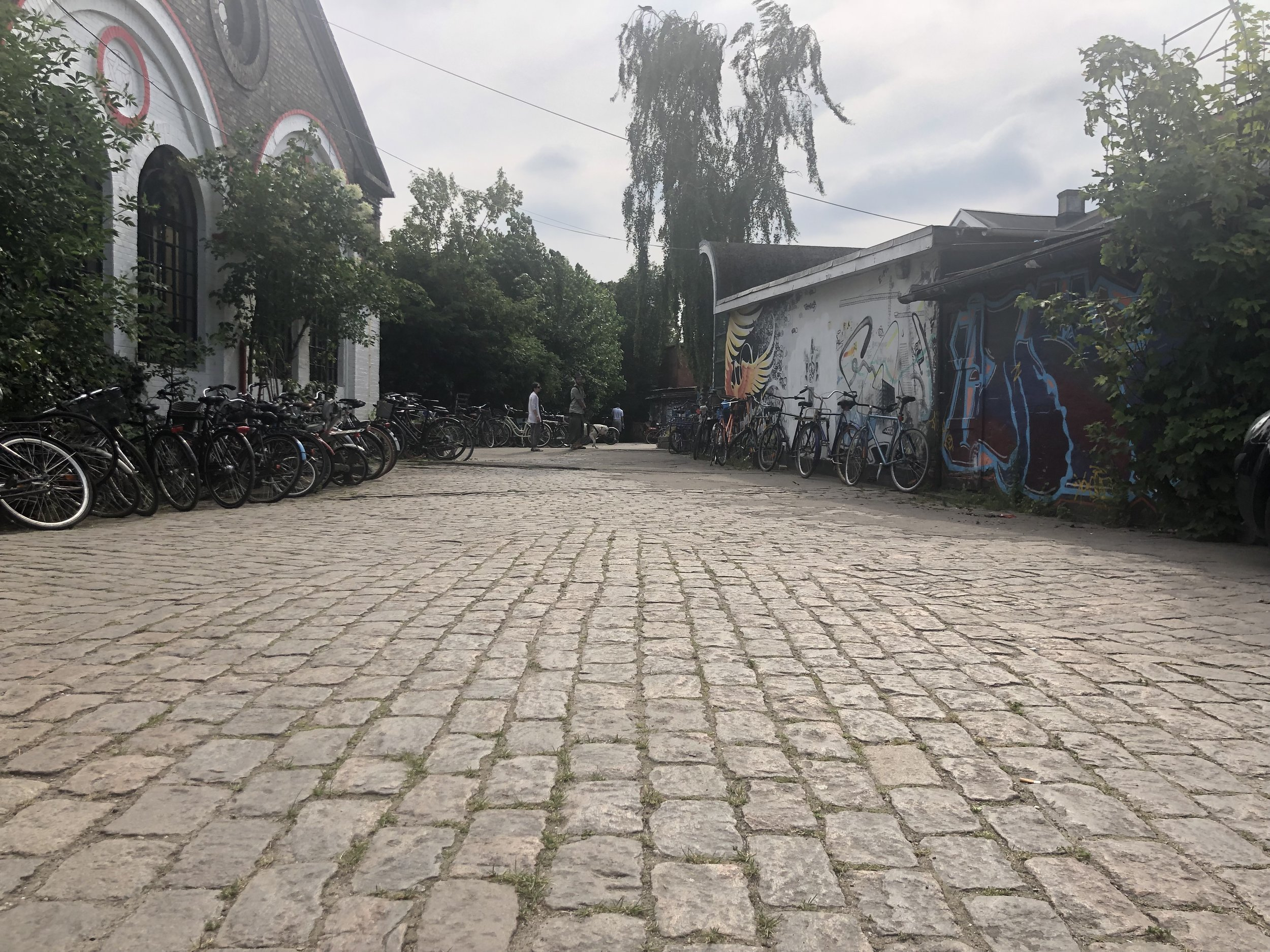 Entrance into Freetown, a section of Copenhagen, where the property owners have established their own government and rules. In Freetown it is legal to sell marijuana, but illegal to take picture beyond this point.