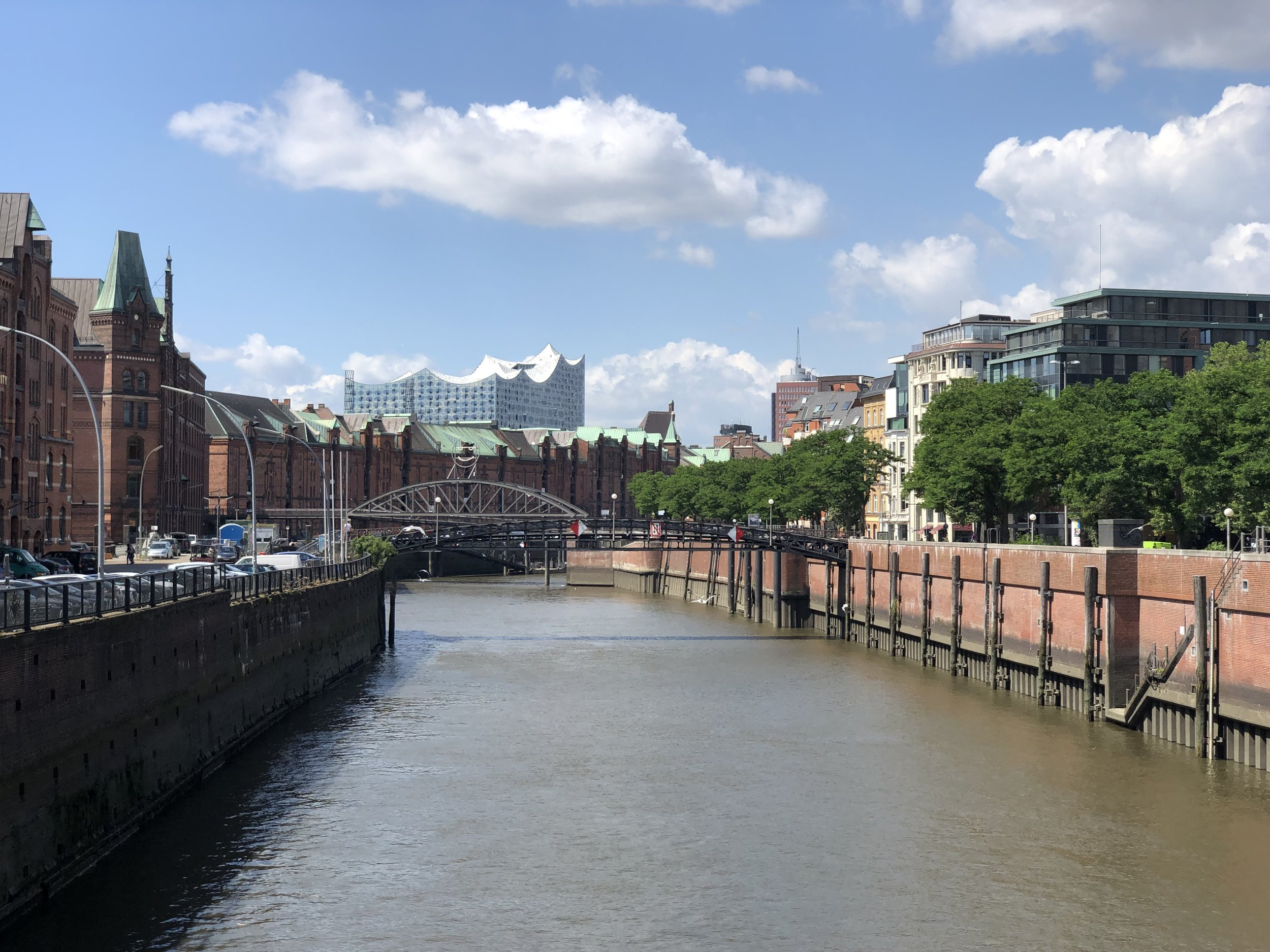 This photo is of a canal in the Hamburg Warehouse District. In the distance is the Elphie which is a fantastic venue for a a wide variety of musical performances.