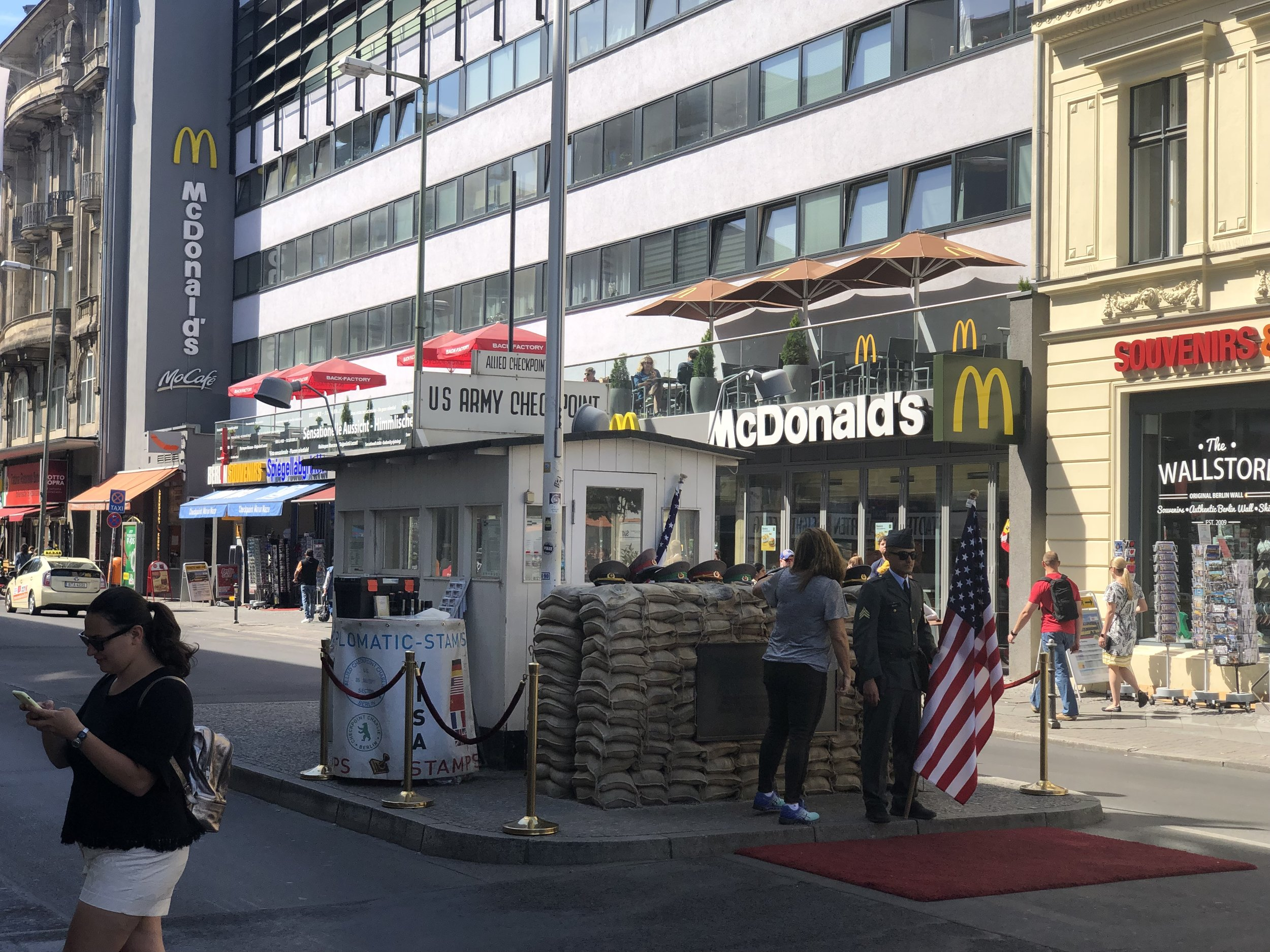 For those old enough to remember this is a photo of Checkpoint Charlie (or a recreation of it). Somewhat ironic that a McDonald's has strategically located a restaurant nearby.
