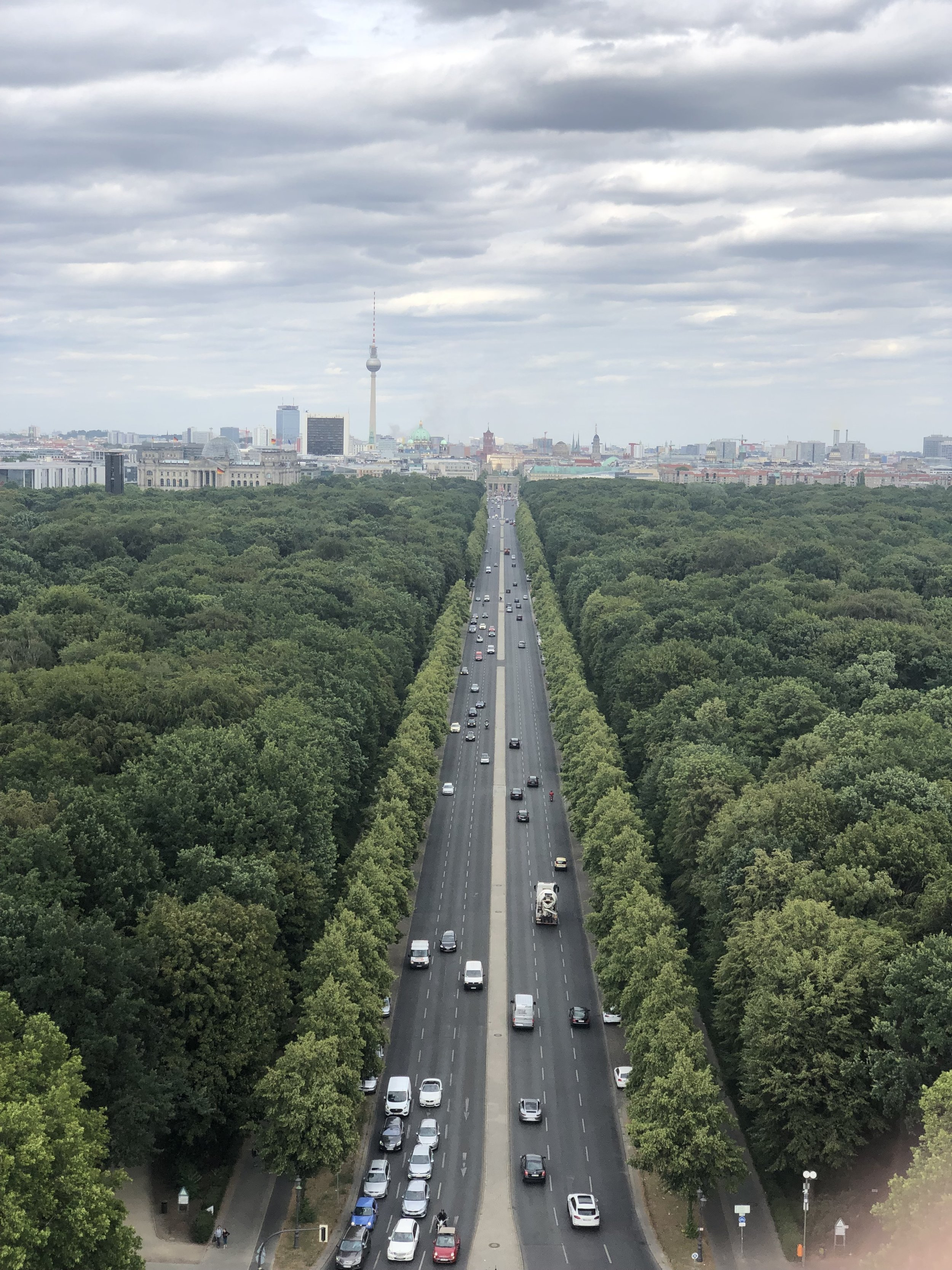 Photo take from the Victory Monument looking down the avenue toward the Brandenburg Gate and the Berlin radio/TV tower.
