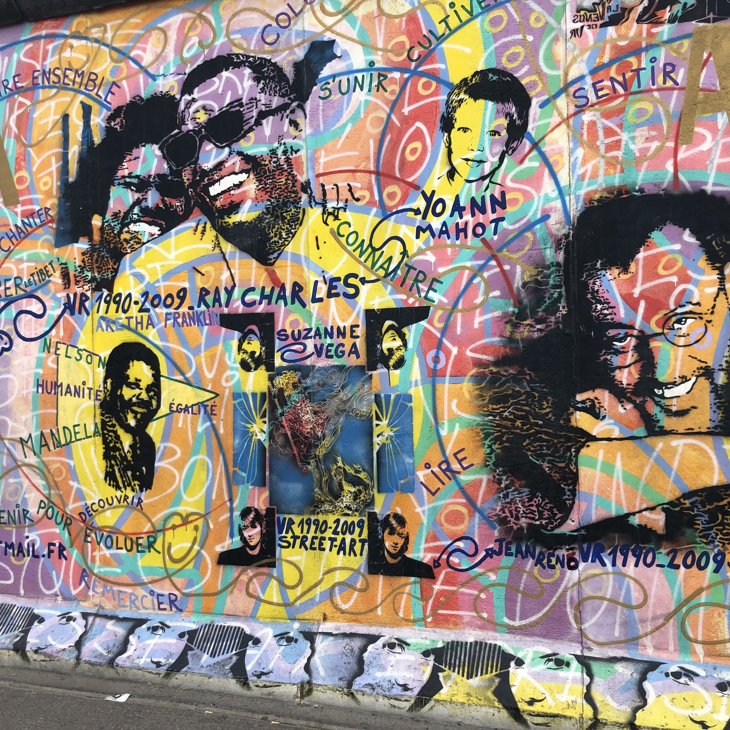 Many of the murals painted on the wall had a theme promoting peace and justice.