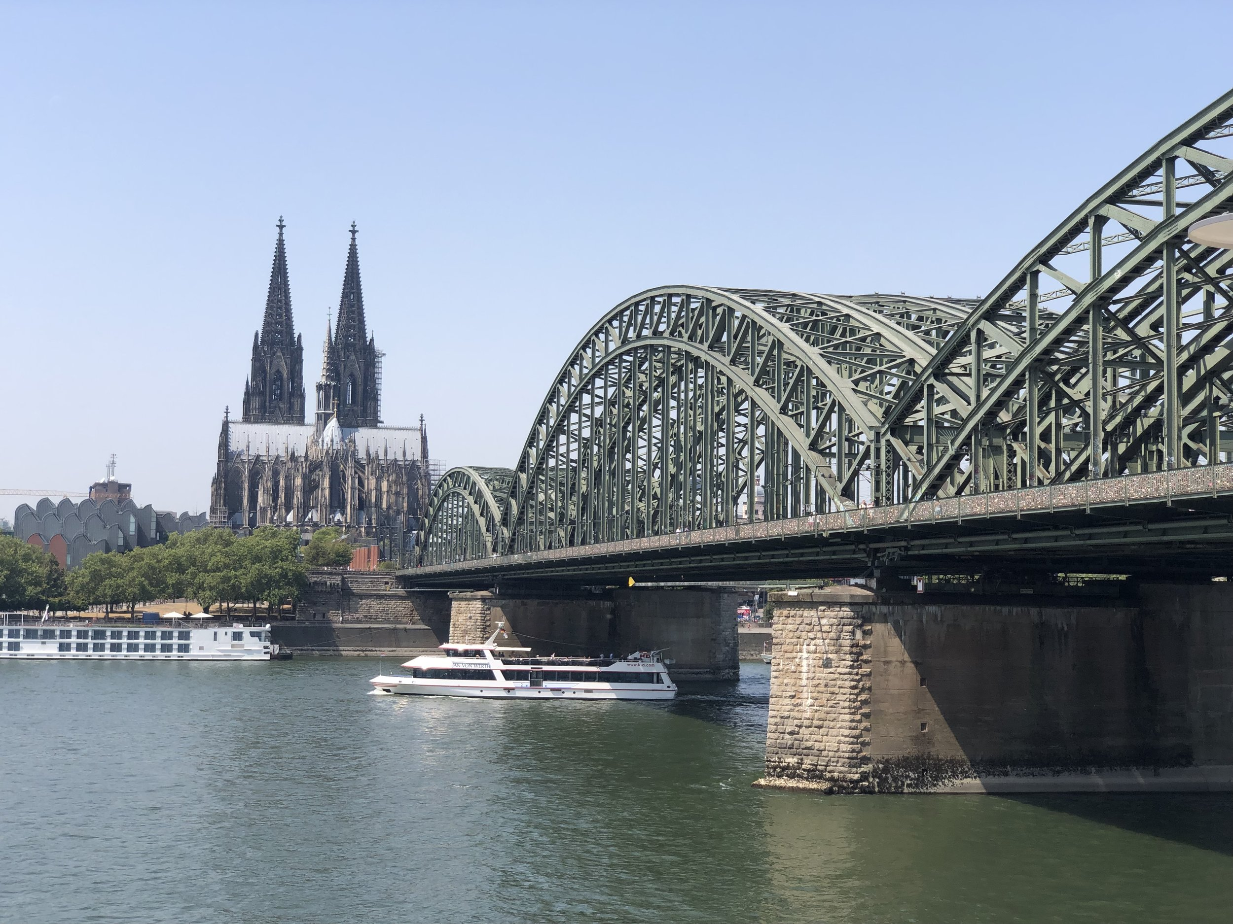 The railroad bridge near the center of Cologne with the cathedral in the background.