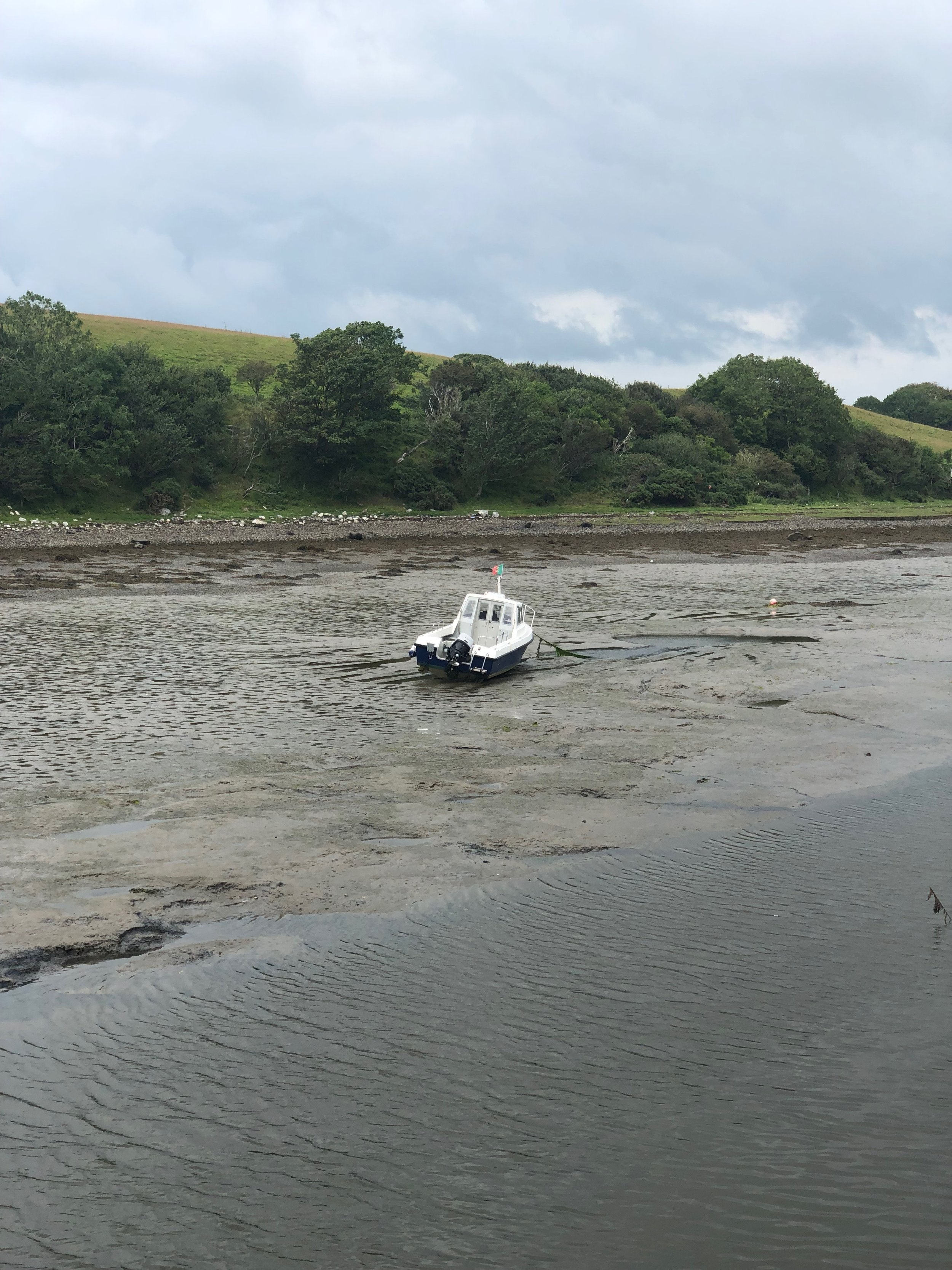 Tides in all of the coastal areas we visited were 3-4 feet. In a few hours this boat would floating again.