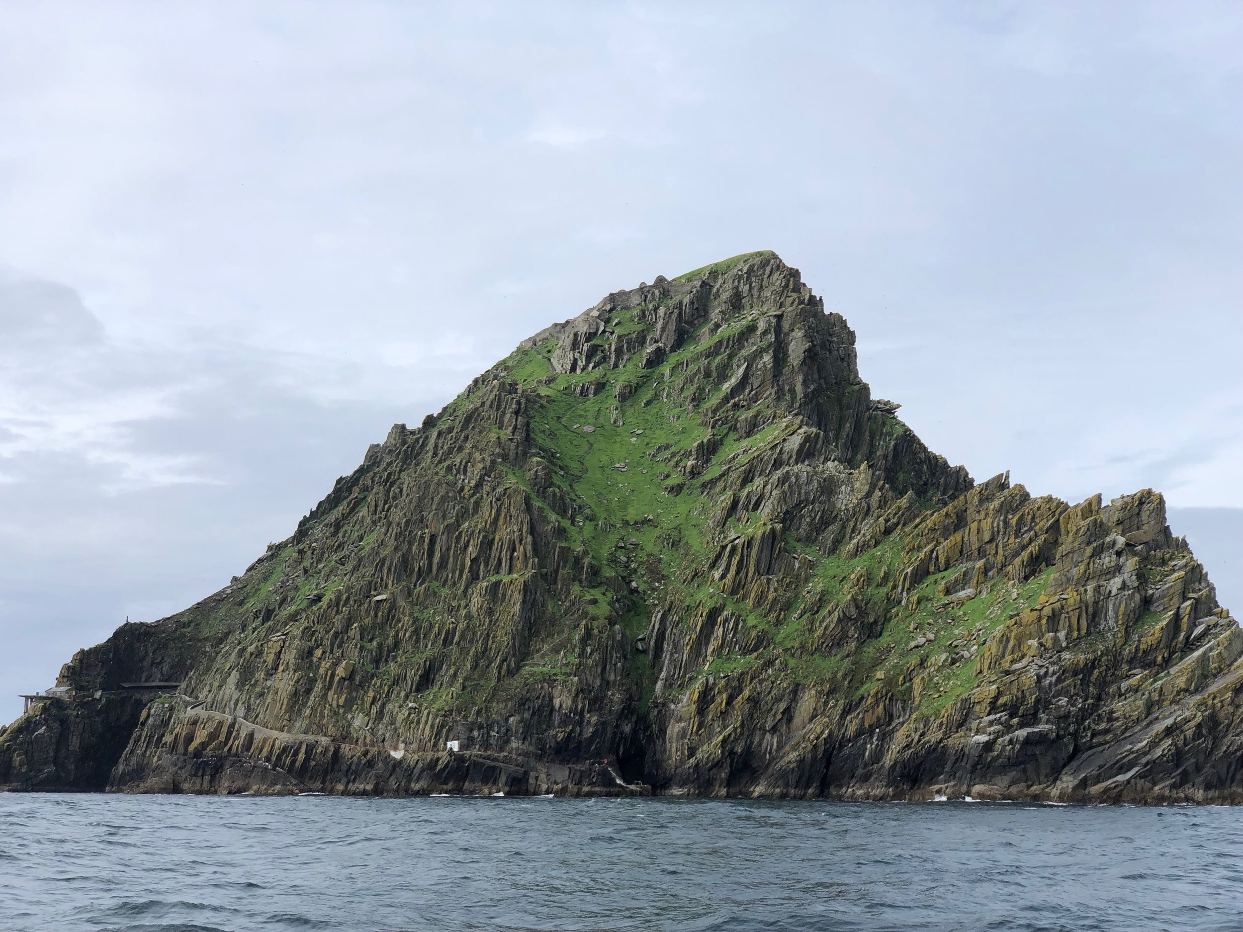 Skellig Michael is rugged rock of an island about 20 miles off the coast of Ireland. Around 300-400 AD monks first landed on the island and built a monastery, the ruins of which still exist today. The two small bumps to the left of the tallest point are beehive structures that the monks built.  Scenes from two Star Wars Movies were also filmed on the Island.