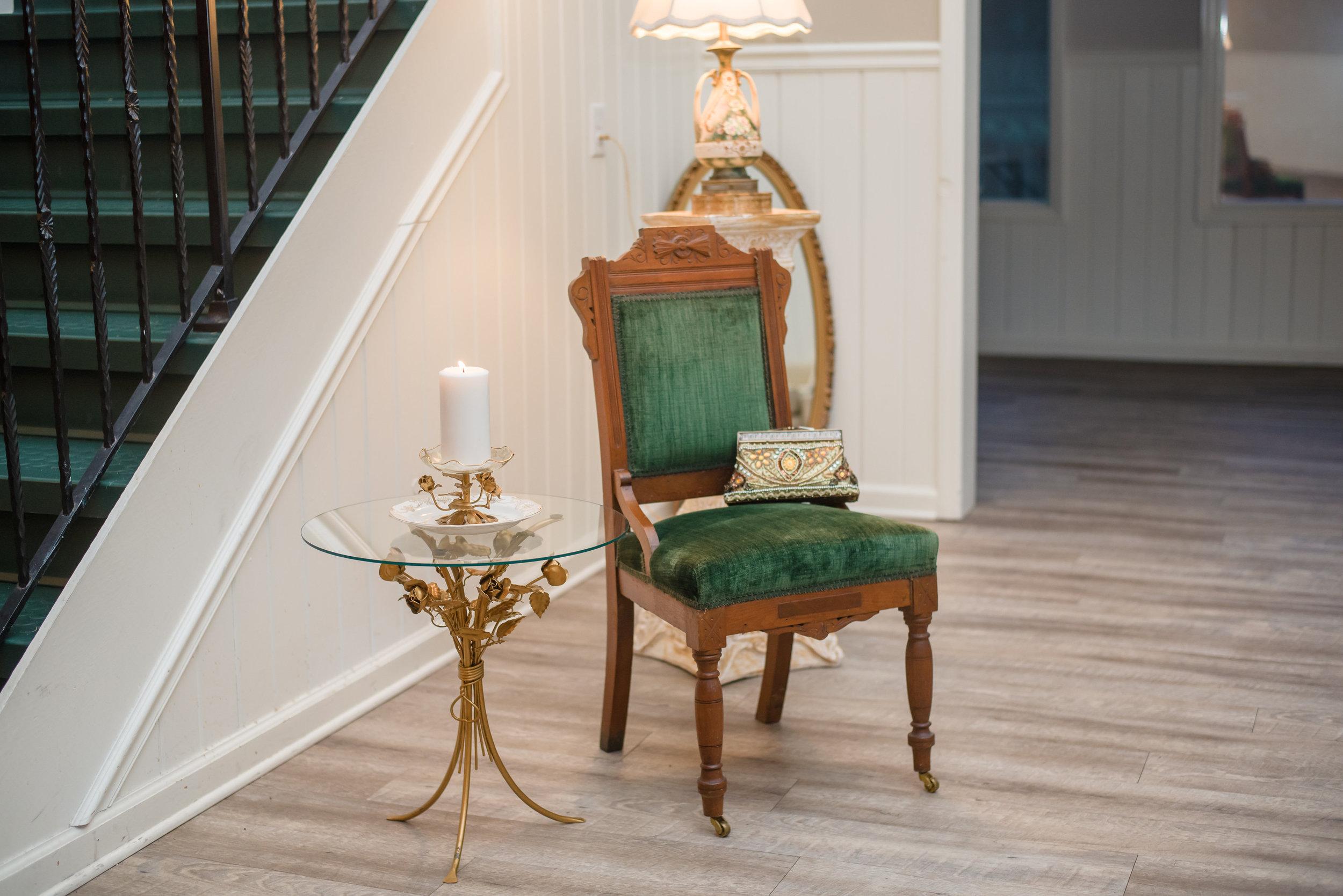 Darcy Chair ,  Prague Table , Wedding Pillars ,  Dish on Rose Pedestal ,  Golden Gatsby Clutch , and  Golden Oval Mirror .