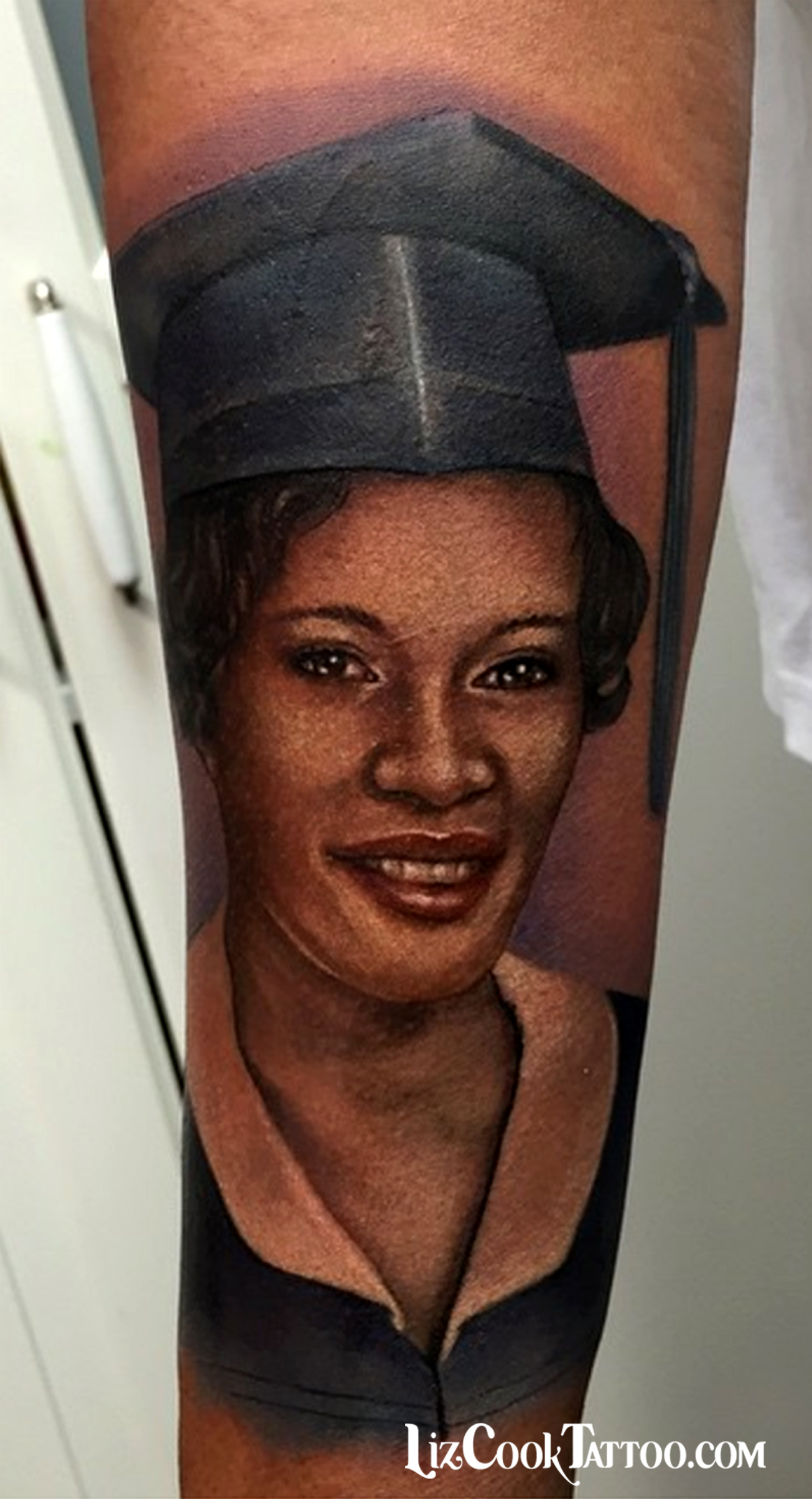 Liz Cook Tattoo Portrait Aunt Graduating Realism Color Dark Skin.jpg