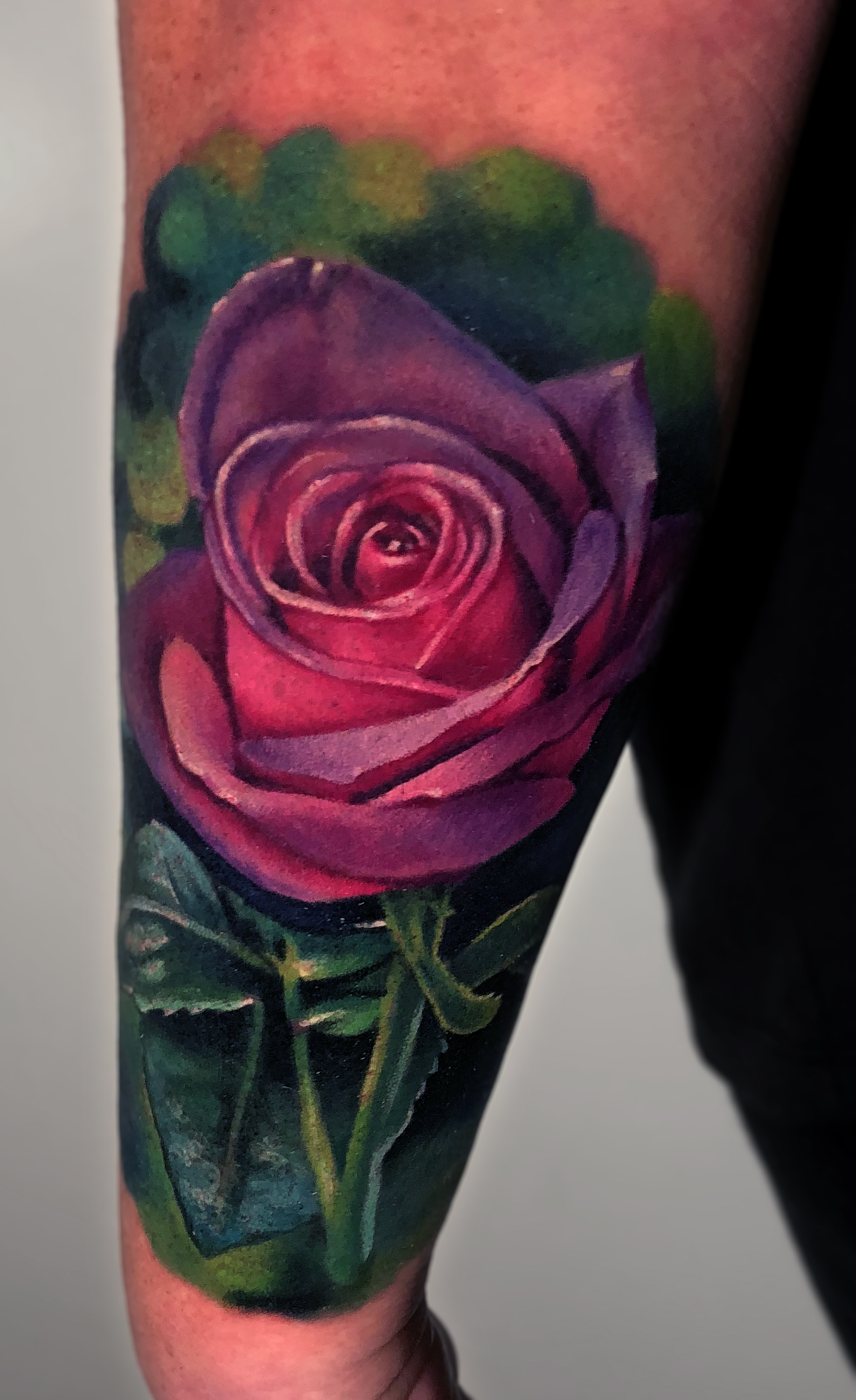 Liz Cook Tattoo Purple Pink Rose Green Stem Background Color Realism.jpg