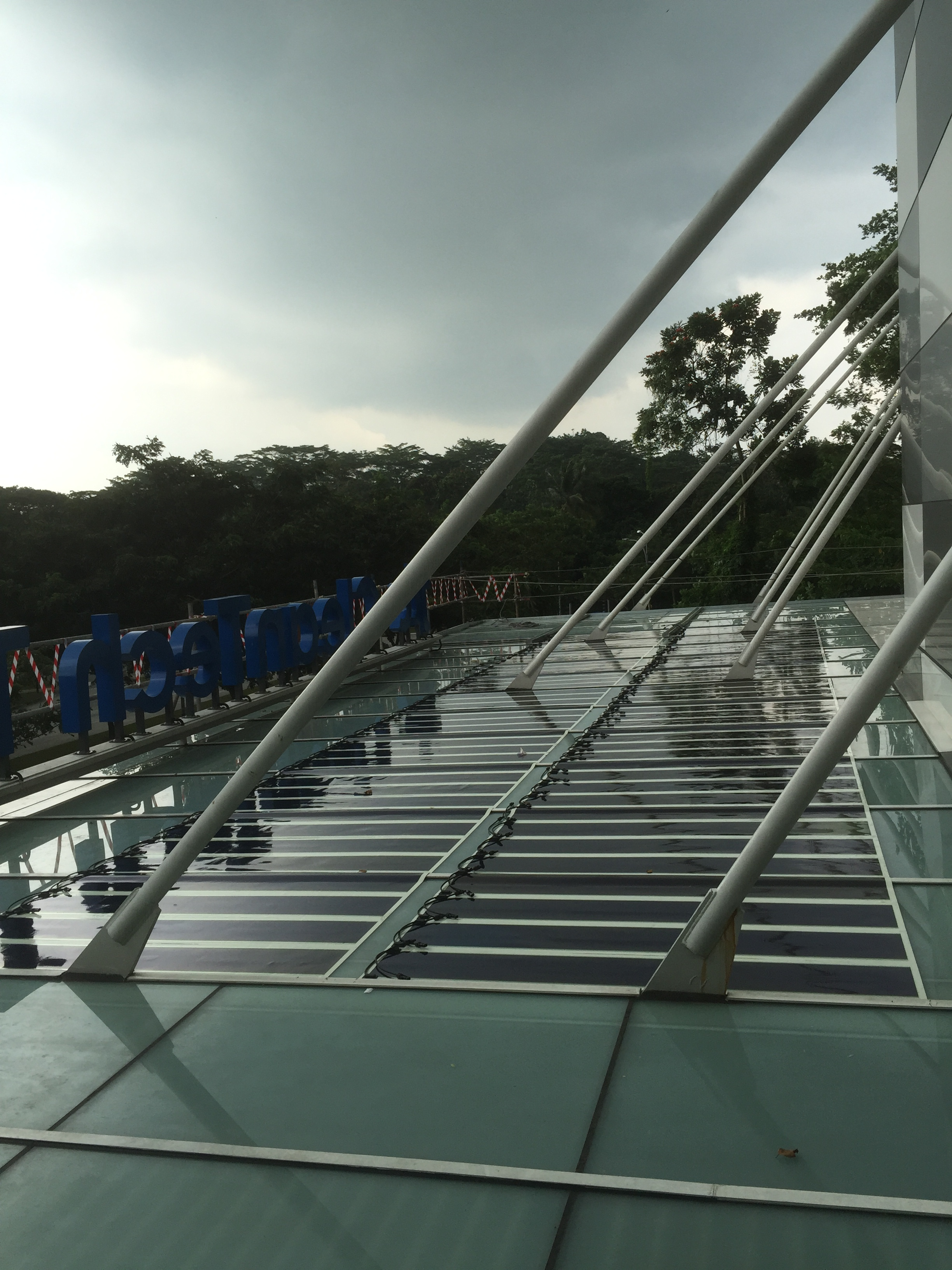 Organic solar photovoltaic (OPV) panels mounted on glass roof