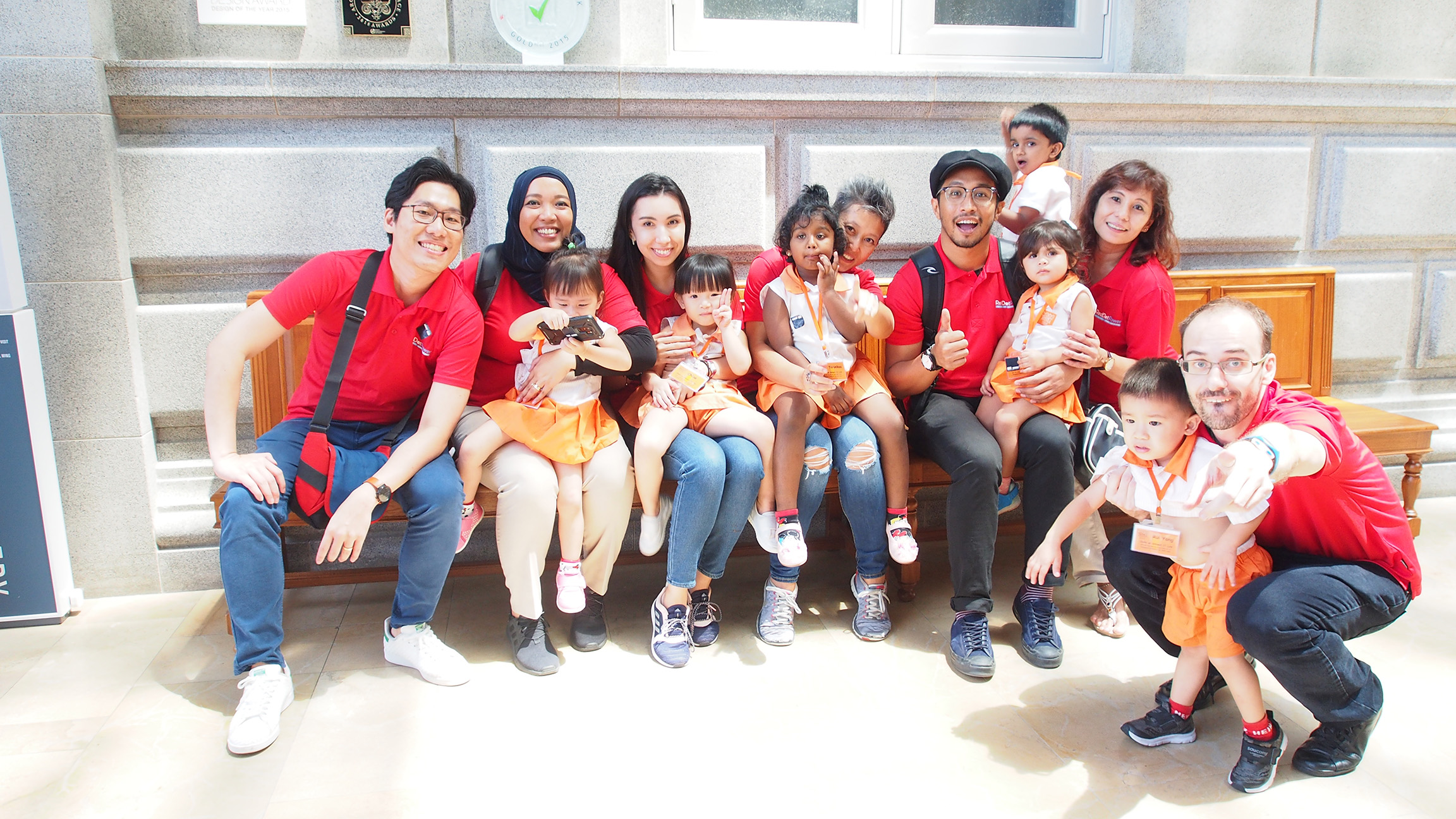 The Red Dot Power team with children from Child at Street 11
