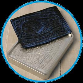 Wood grain tool and sample vacuum formed plastic