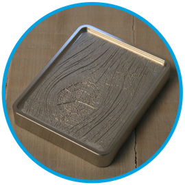 CNC machined wood grain into aluminium tool
