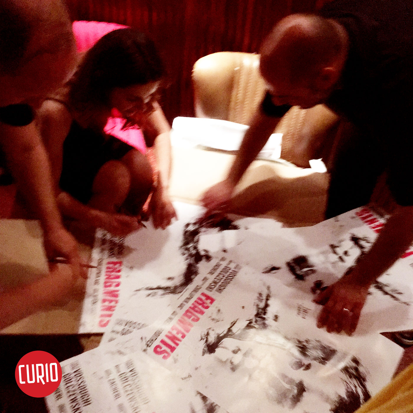 Cast and crew at premier of Fragments signing the film poster - poster design by Cesare Asaro of Curio & Co.