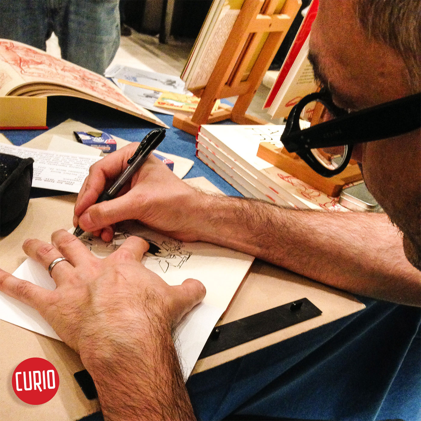 Cesare Asaro of Curio & Co. signing at IndiComics at Wien Museum in 2017