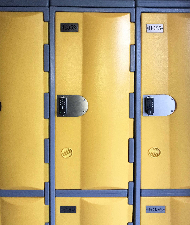 Two door yellow heavy duty plastic lockers with round combination locks