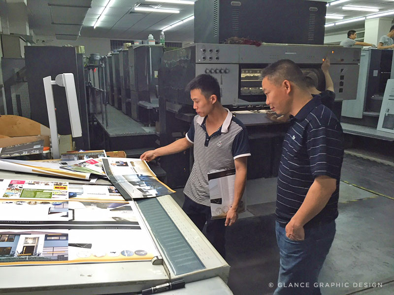 Mr Jim Chen pictured on the right, over seeing a recent print project. © Glance Graphic Design
