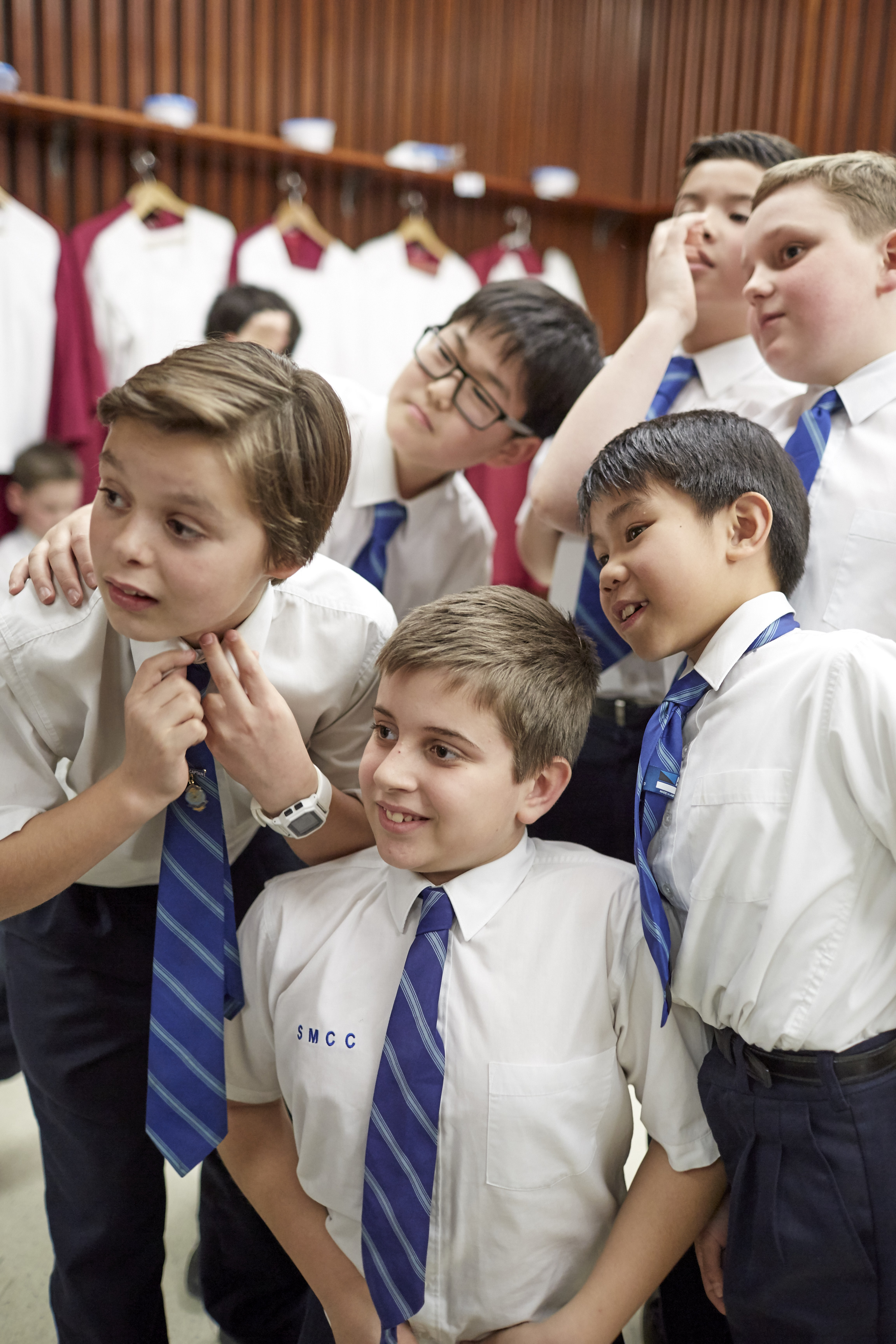 Choristers of Saint Mary's Cathedral Choir prepare to put on their robes
