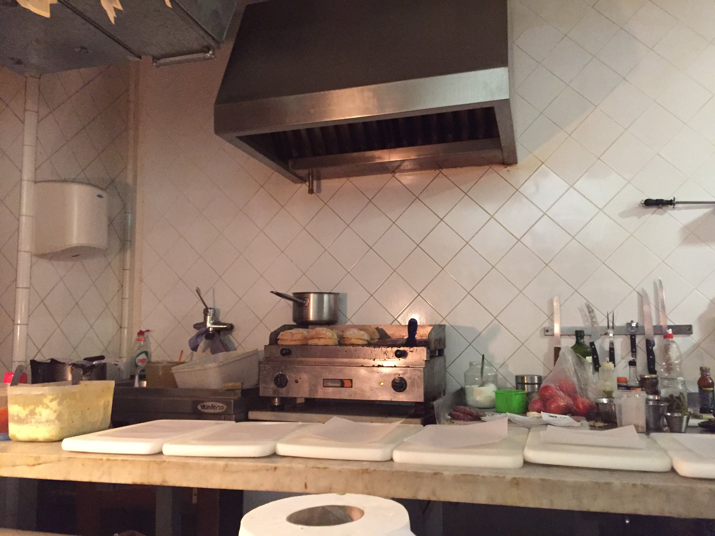 The little open kitchen greets you upon entering
