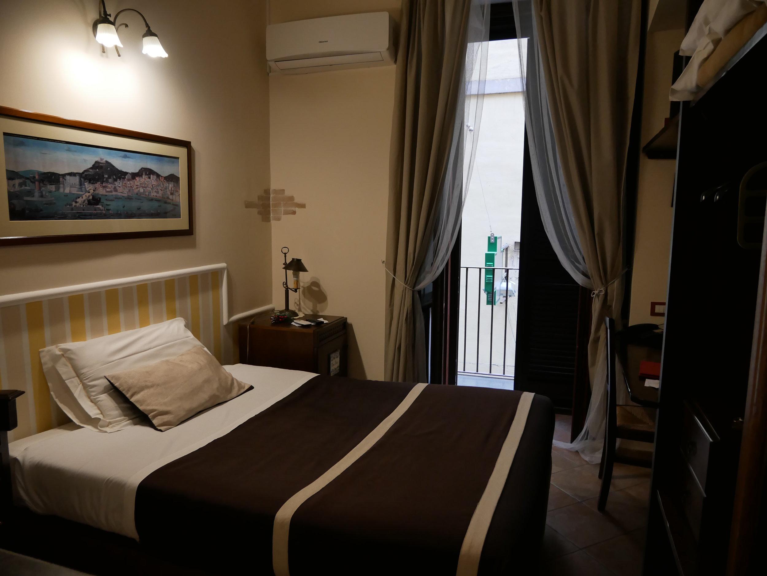 Il Convento Hotel Naples bed.jpg