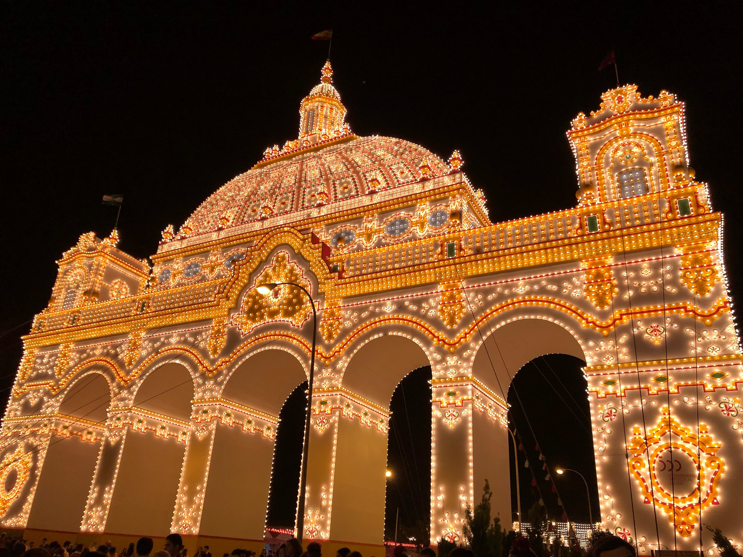 And here is the Portada, the main gate of the fairgrounds, magnificently lit up at night.