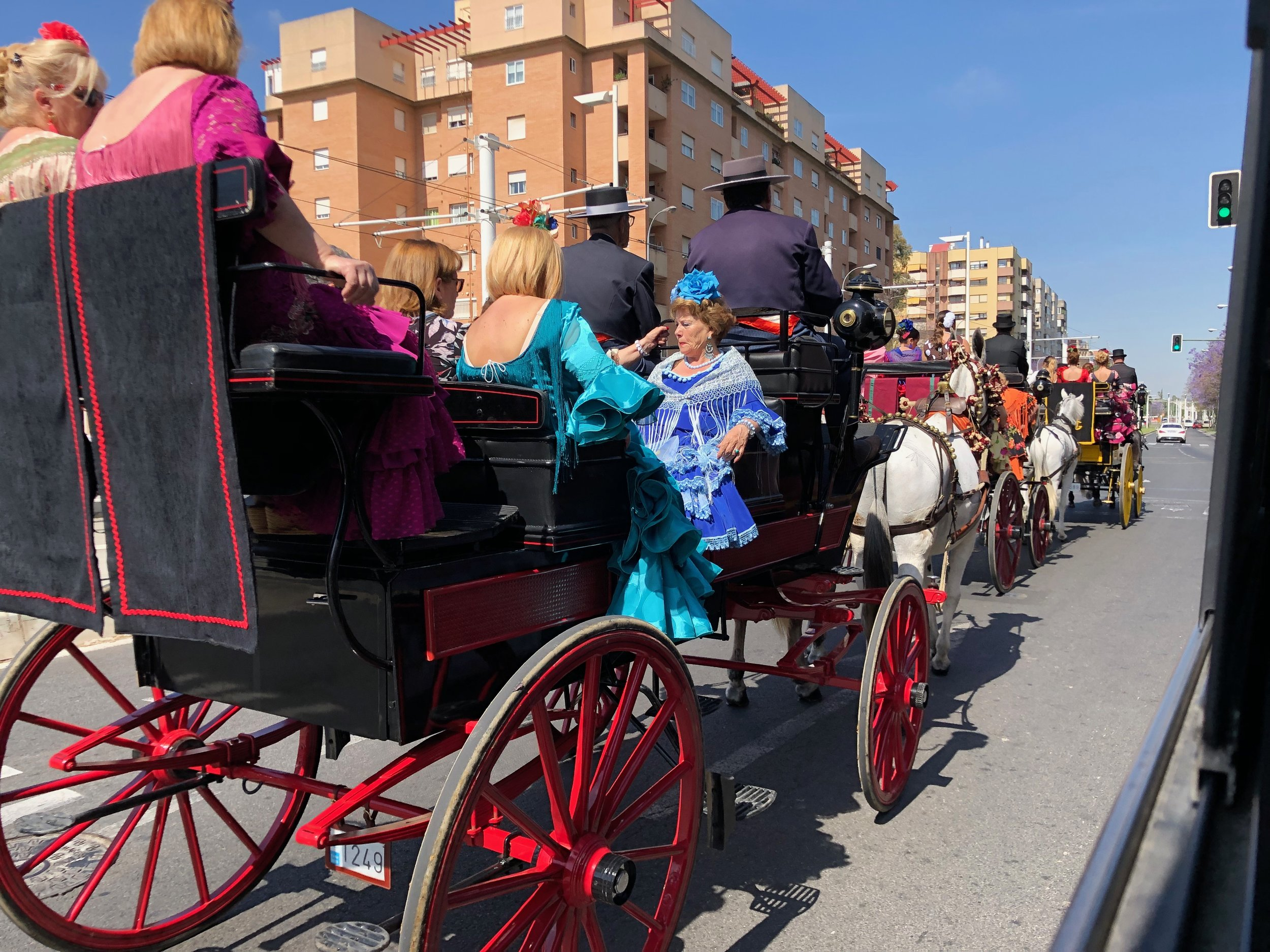 The horse-drawn carriages and their dressed up passengers mingle with cars and buses on the roads to the fair.
