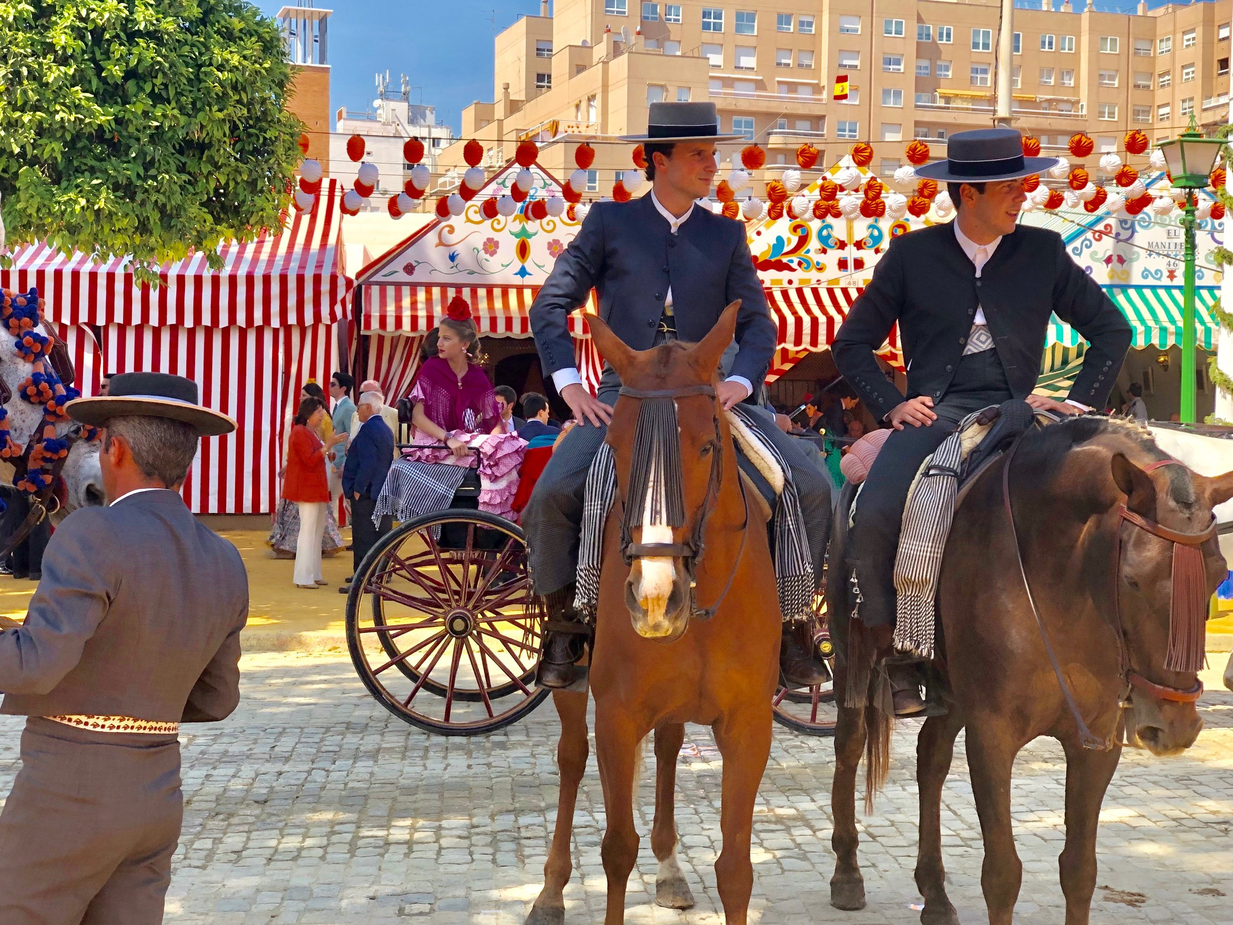 And the men who ride around in horses get to wear the sharp looking Cordobés hats and suits.