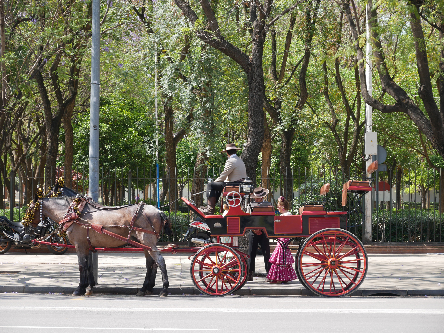 The horse-drawn carriages and traditional dress of the Feria can be found well outside of the fairgrounds.