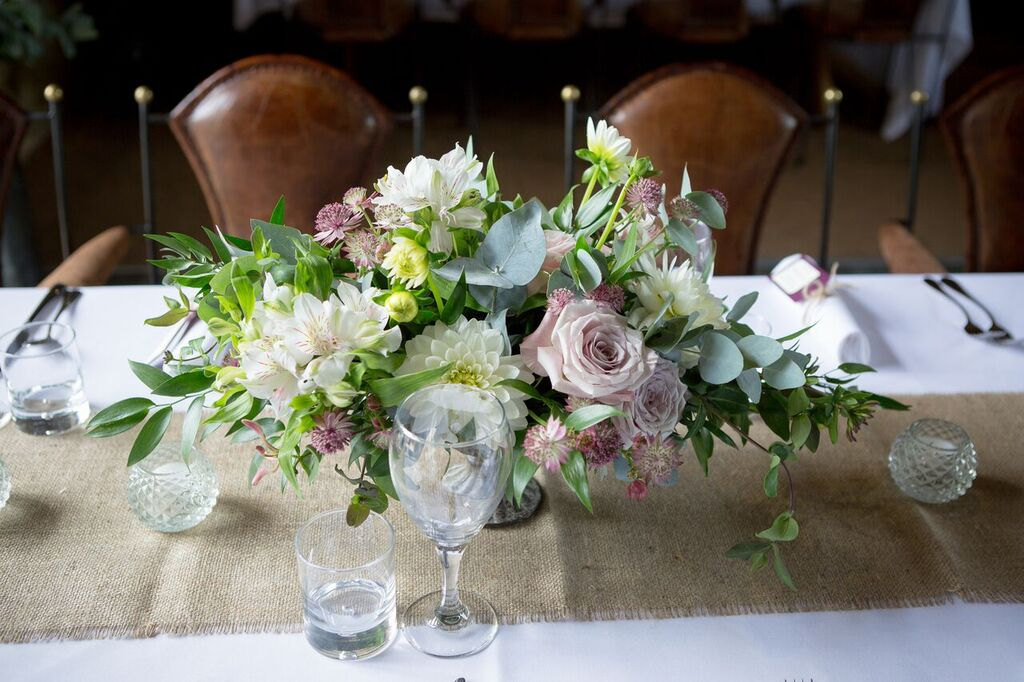 Blush and berry wedding flower centrepiece