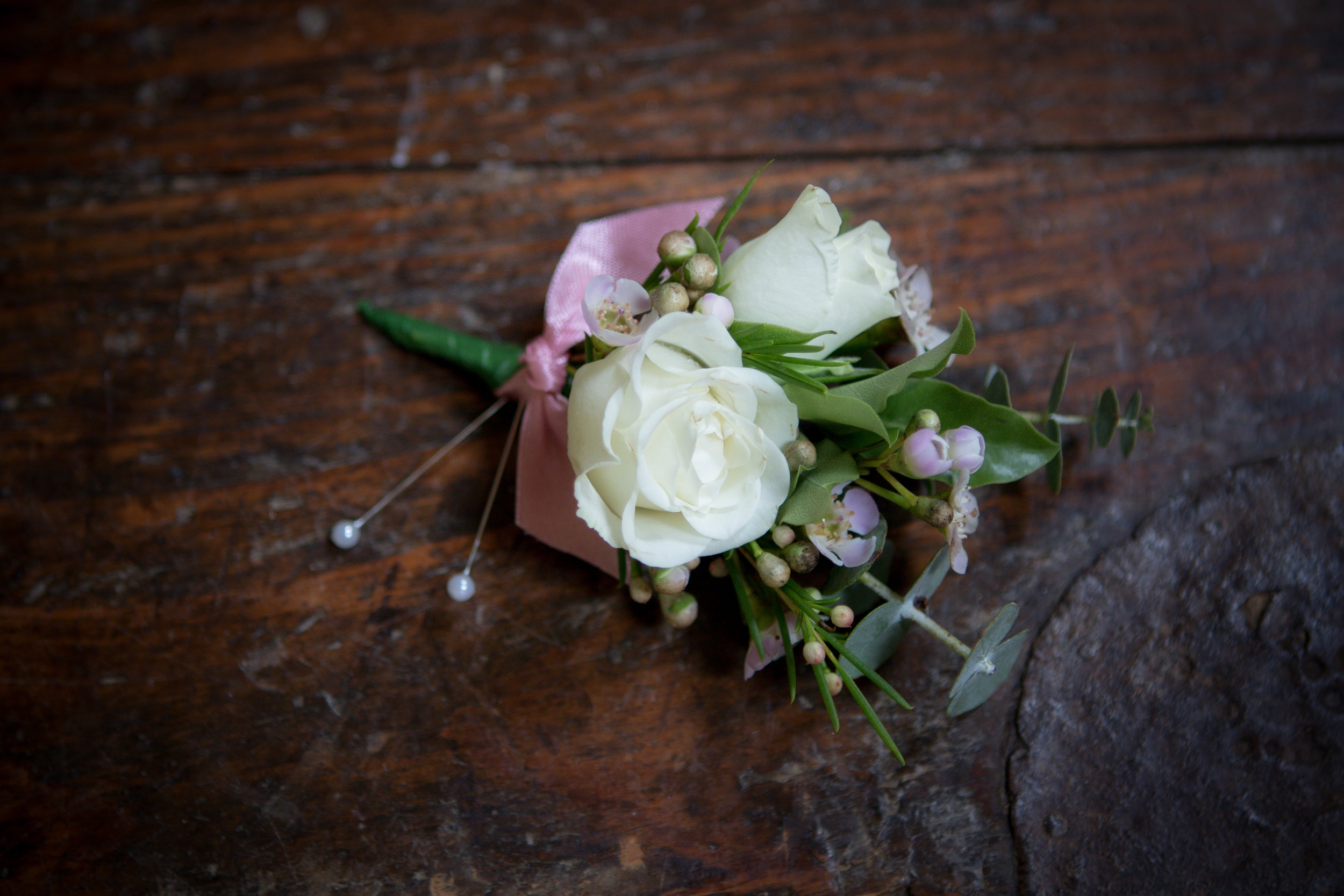 Blush and cream garden style buttonholes