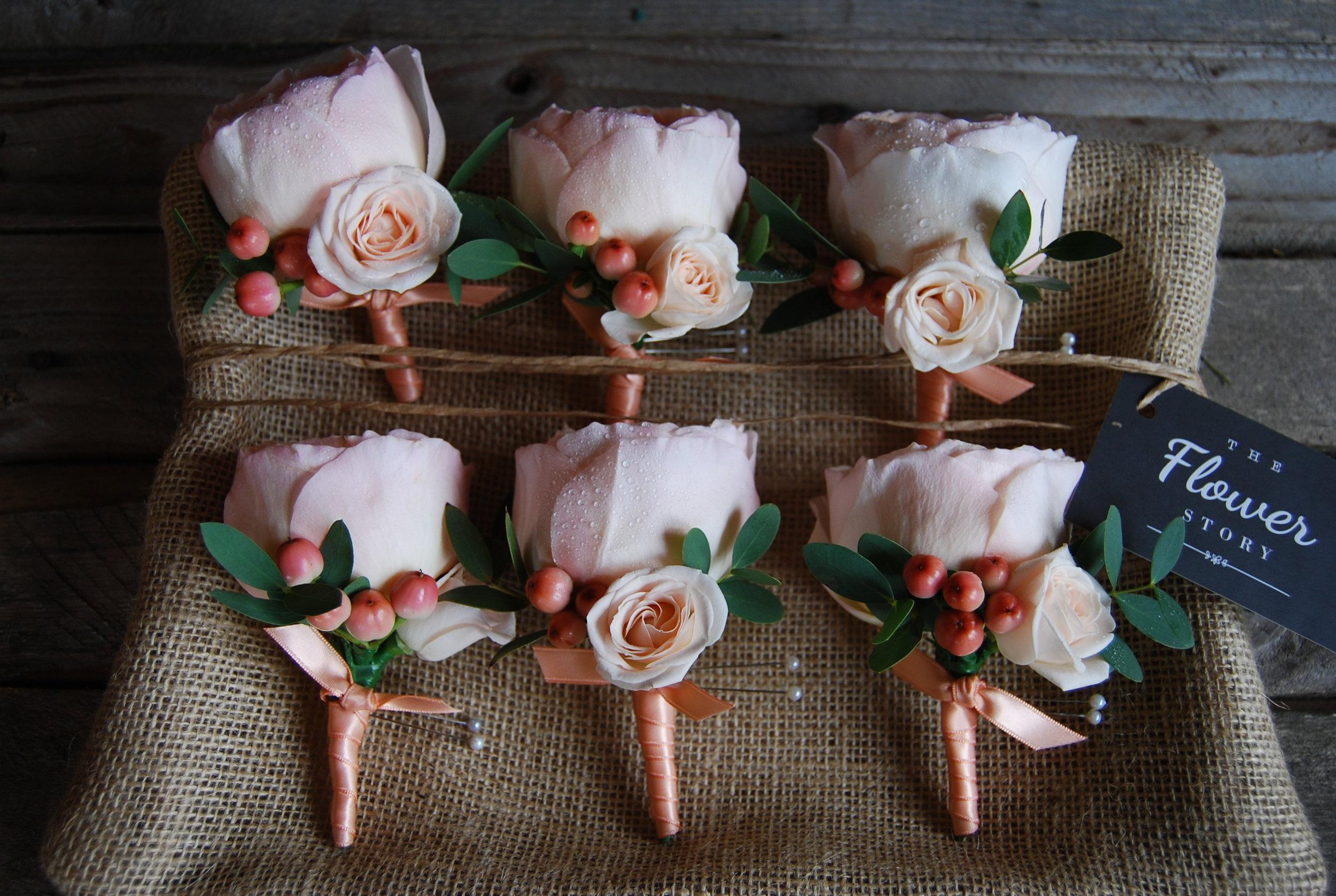 'Juliet' garden rose buttonholes for the boys