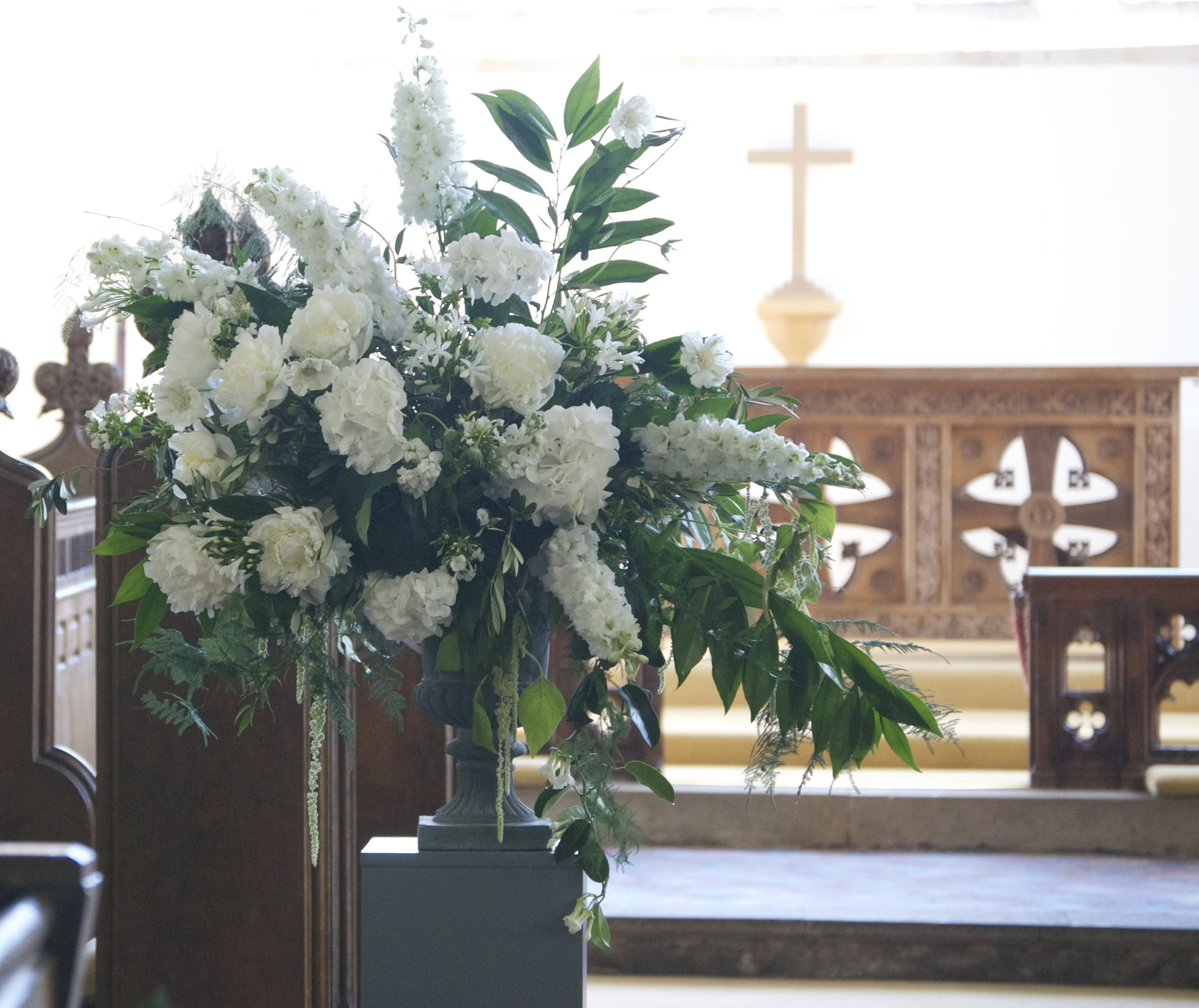 Green and white church flowers. Image by  Phil Barnes Photography
