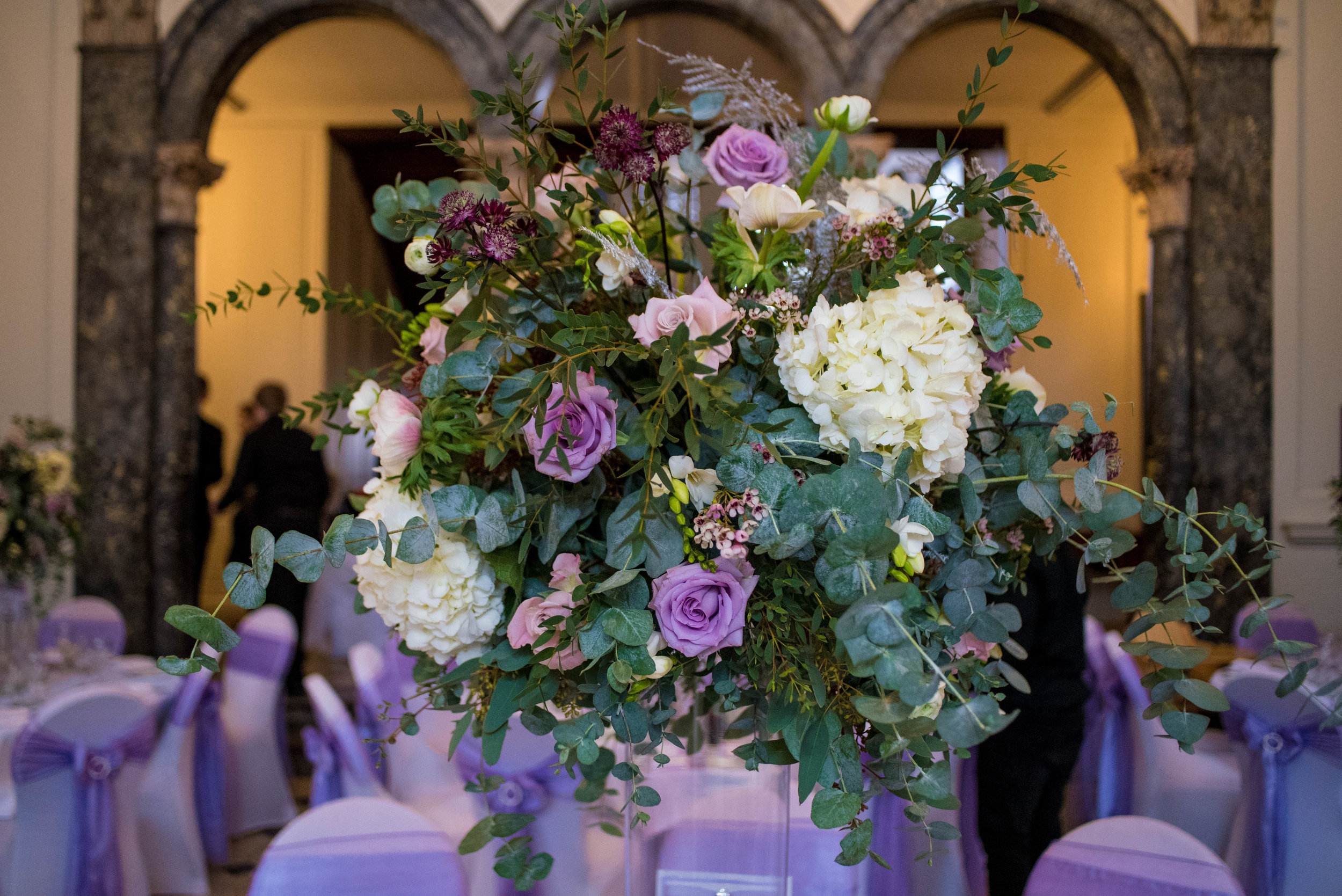 Tall centrepieces full of hydrangeas, roses, freesias and anemones
