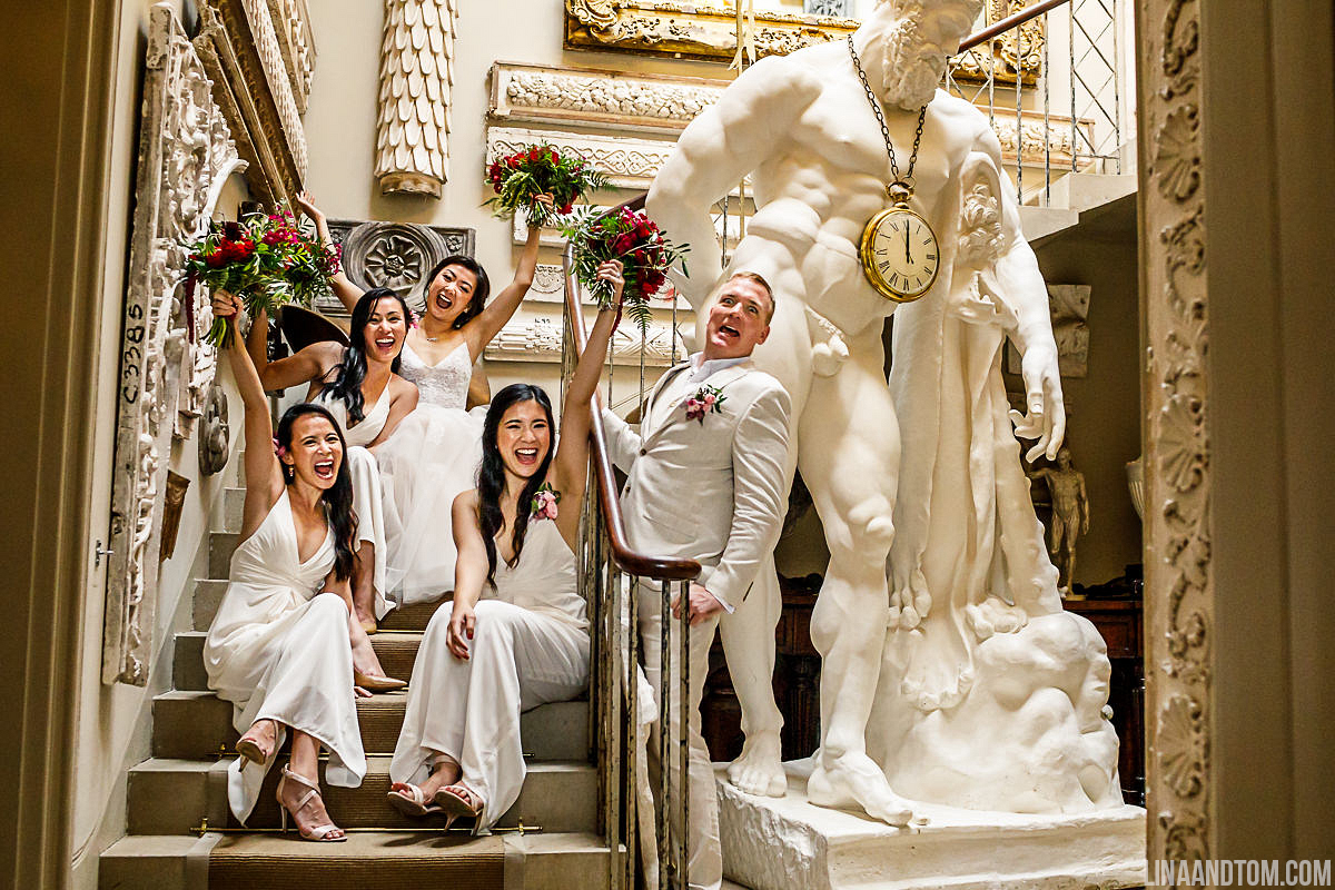 Bridal party celebrating at Aynhoe Park carrying flowers by The Flower Story