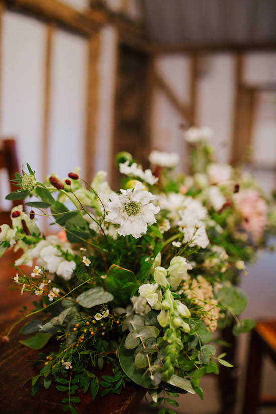 Long and low blush and white floral table arrangement.  Full of dahlias, snapdragons, wax flower and eucalyptus by The Flower Story