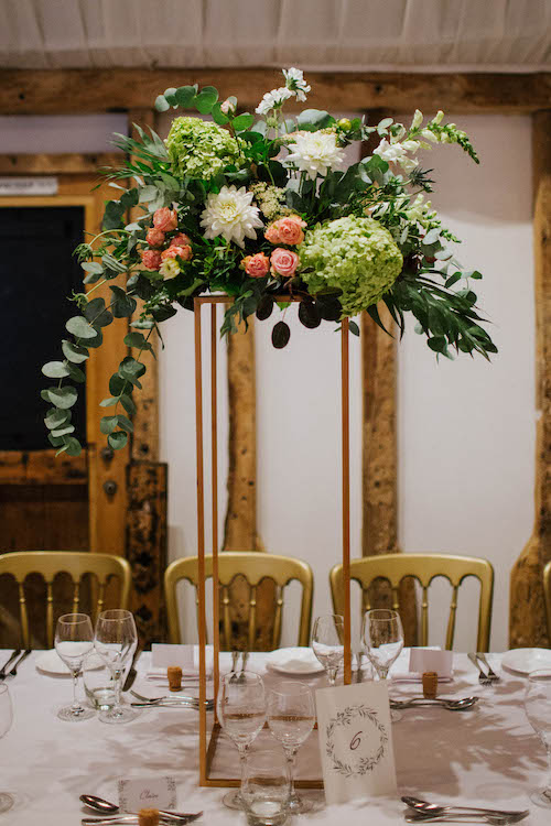 Green, white and blush wedding table arrangement on top of copper square stand by The Flower Story