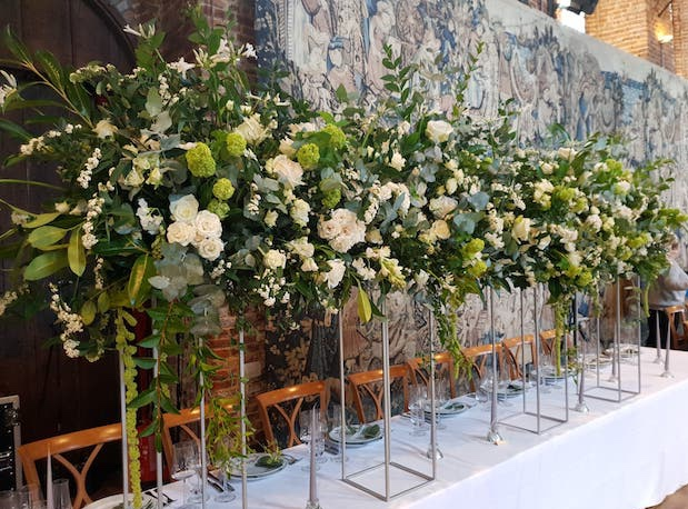 Green and white wedding flowers by The Flower Story