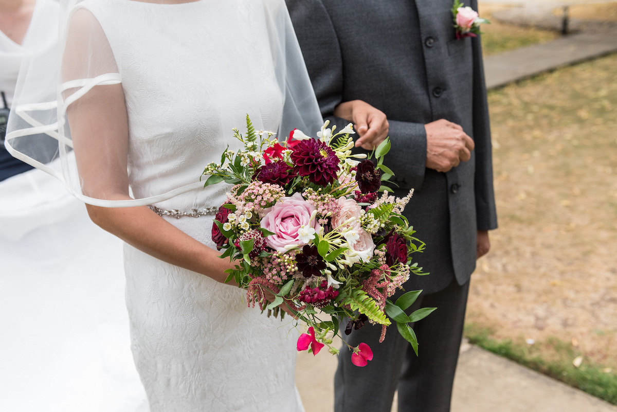 Delicate cascade wedding bouquet in blush and crimson