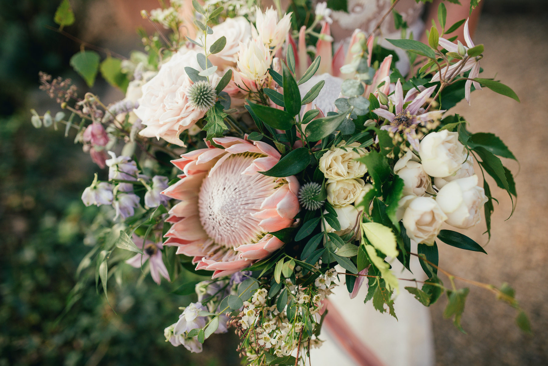 Protea and faded pastels wedding bouquet for Ella and Tom by The Flower Story.
