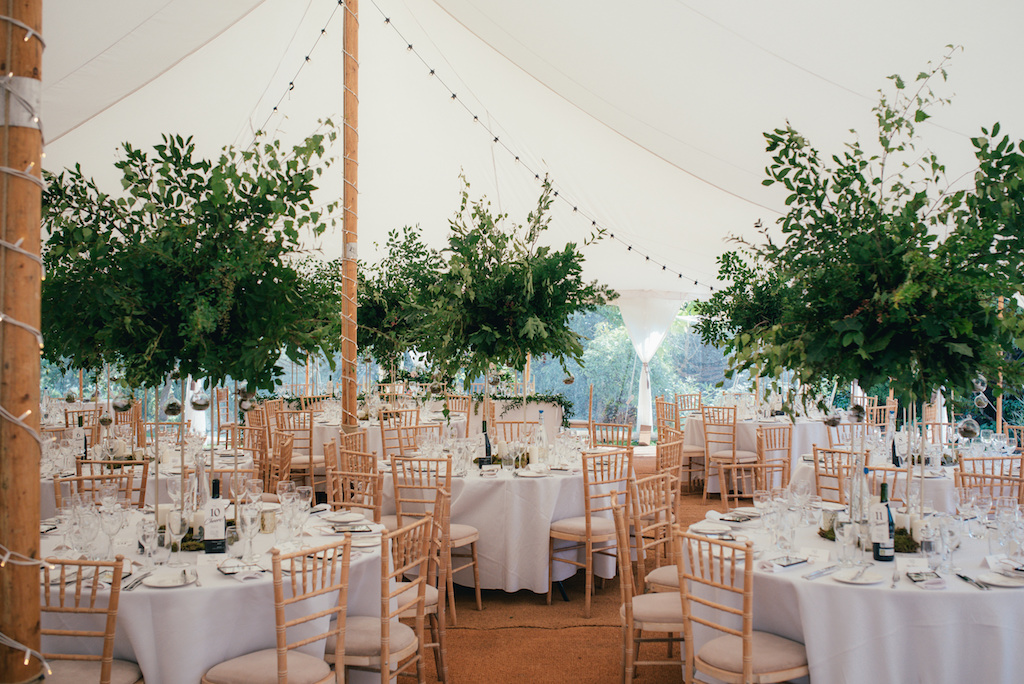 Foliage filled marquee for garden wedding by The Flower Story