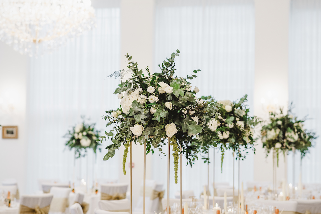 Elevated green and white wedding centrepieces by The Flower Story
