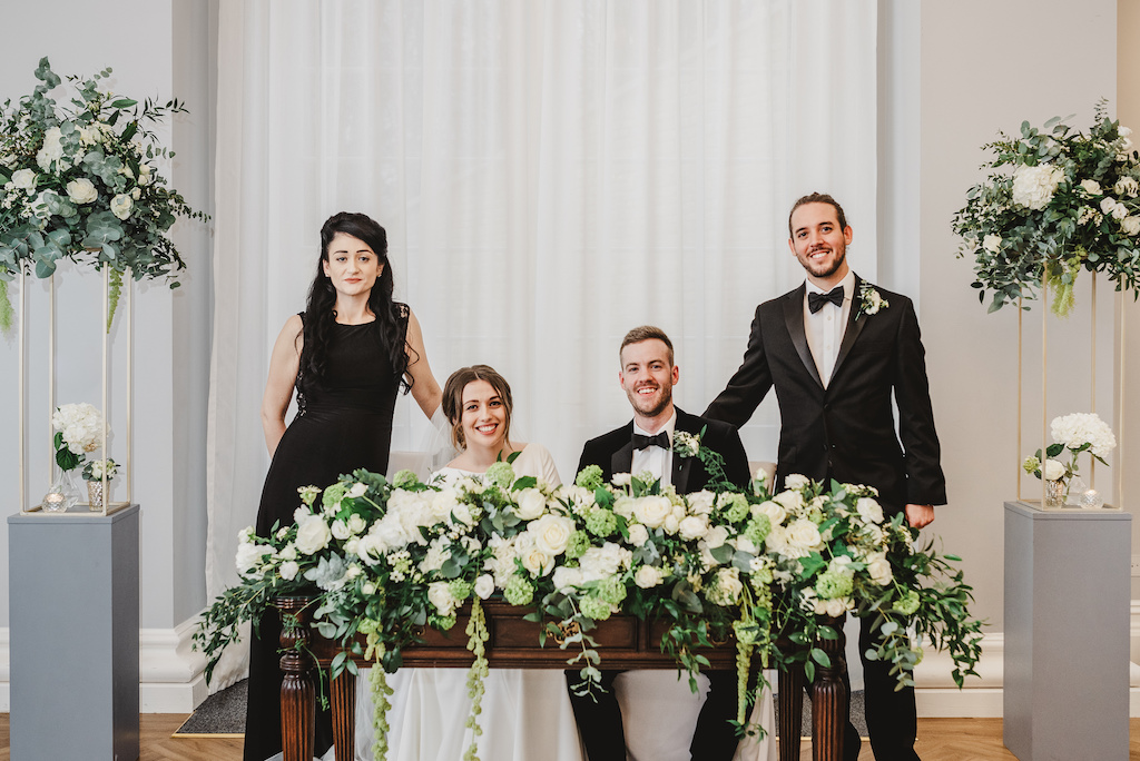 Elegant green and white wedding at Rushton Hall. Flowers by The Flower Story