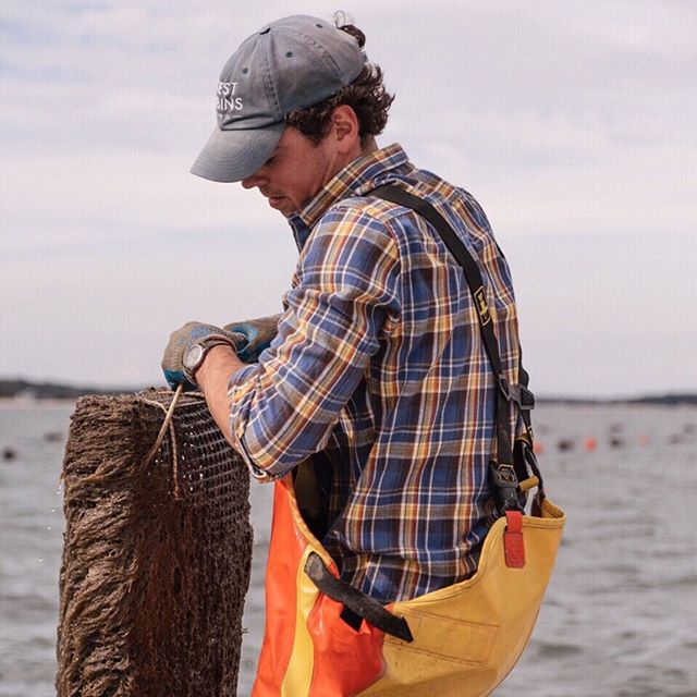 Walker in his (oyster) bag. . . . . . . . #farming #oysterfarming #oysters #savetheeartheatfarmedoysters #sustainablefarming #aquaculture #EastEnd #Hamptons #LongIsland #NewYork