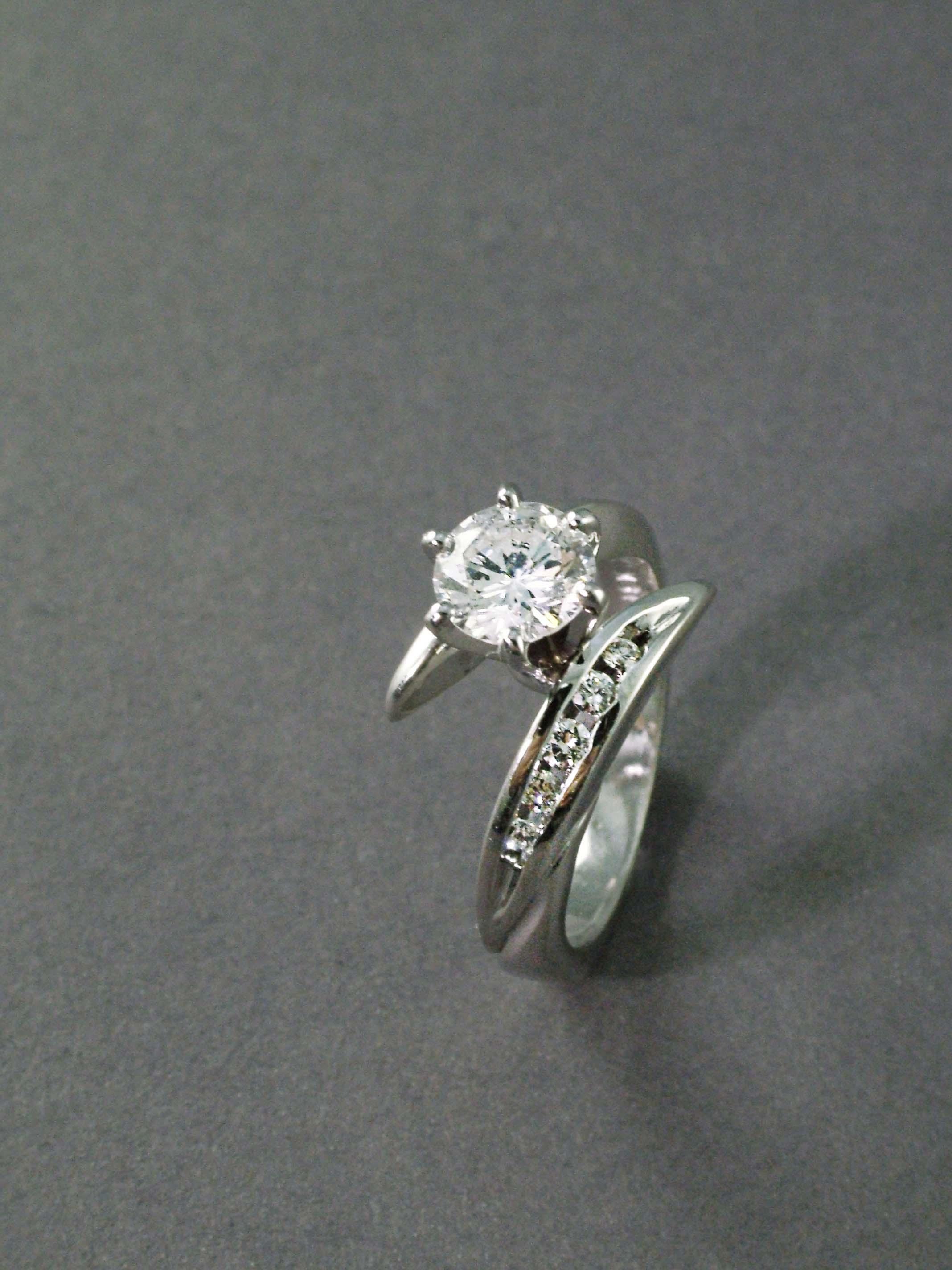 modern_twist_engagement_ring_redford_jewelers.jpg